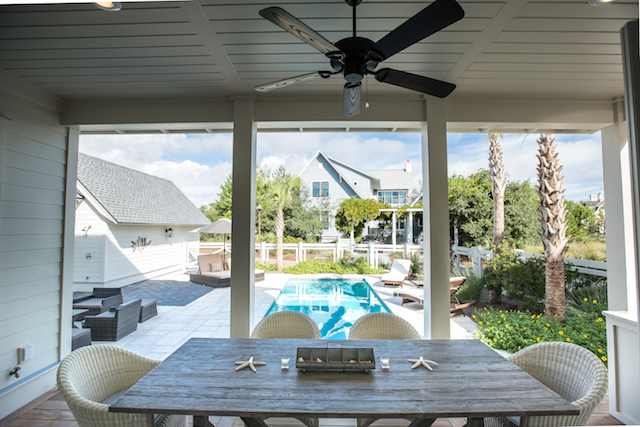 Perfect spot for dining outdoors overlooking the pool with built-in gas grill/cooking area
