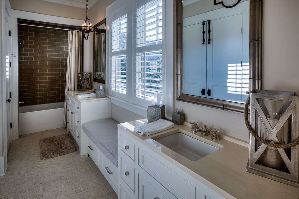 Ensuite bathroom with dual vanities and shower/tub combo