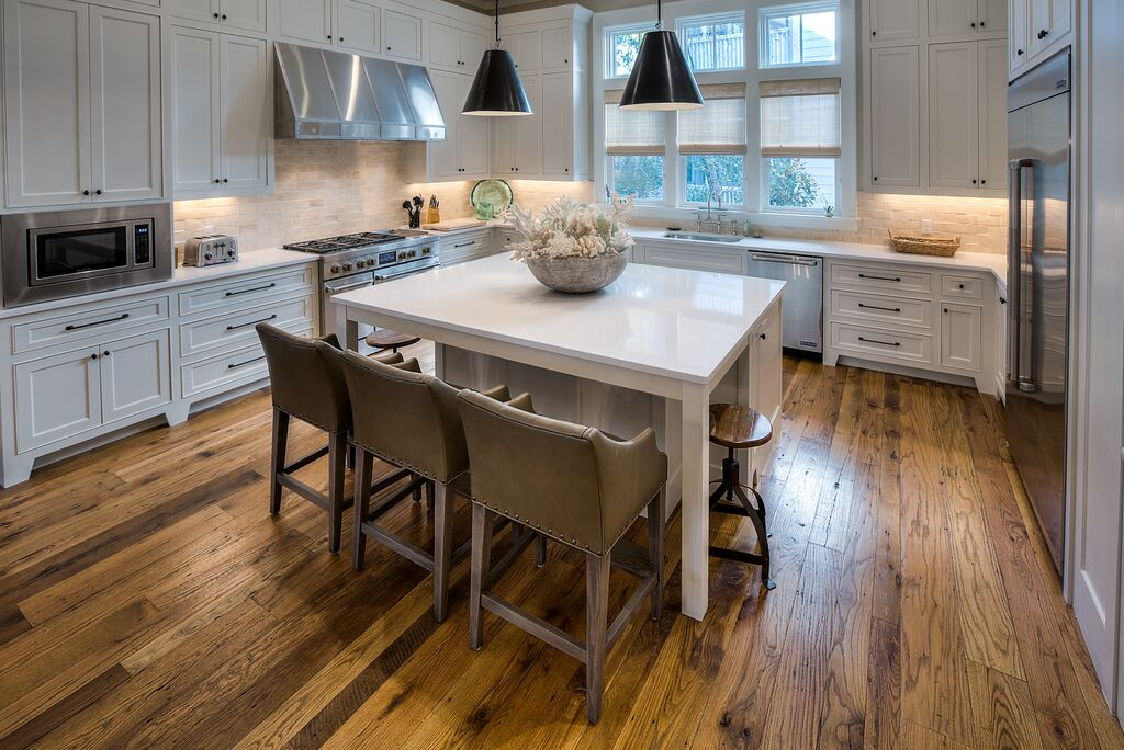 Gorgeous Airy Kitchen with Top of the Line Stainless Steel Appliances and Large Center Island with Seating for 5