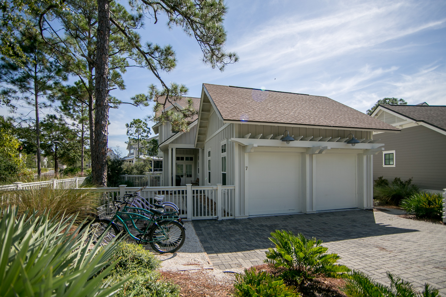Driveway fits 2 cars plus there is use of the right side of the garage; it also has a convenient bike rack; front entrance area has a large gas grill and entryway to a mudroom next to the laundry room