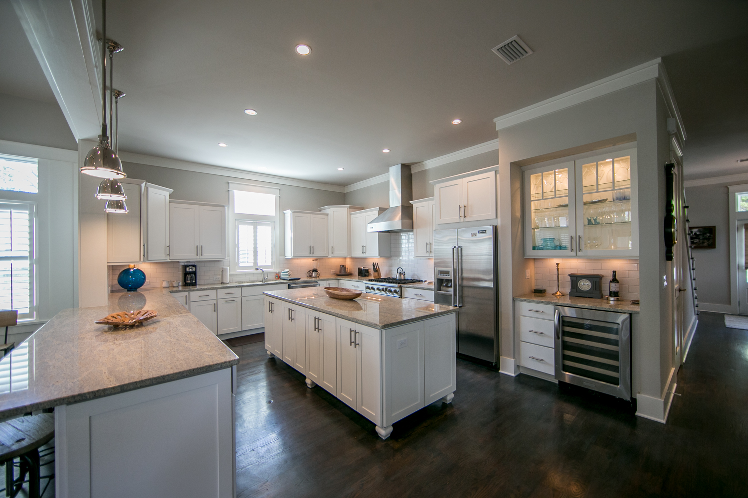Grand gourmet chef's kitchen with Viking stainless steel appliances and a spacious wine bar