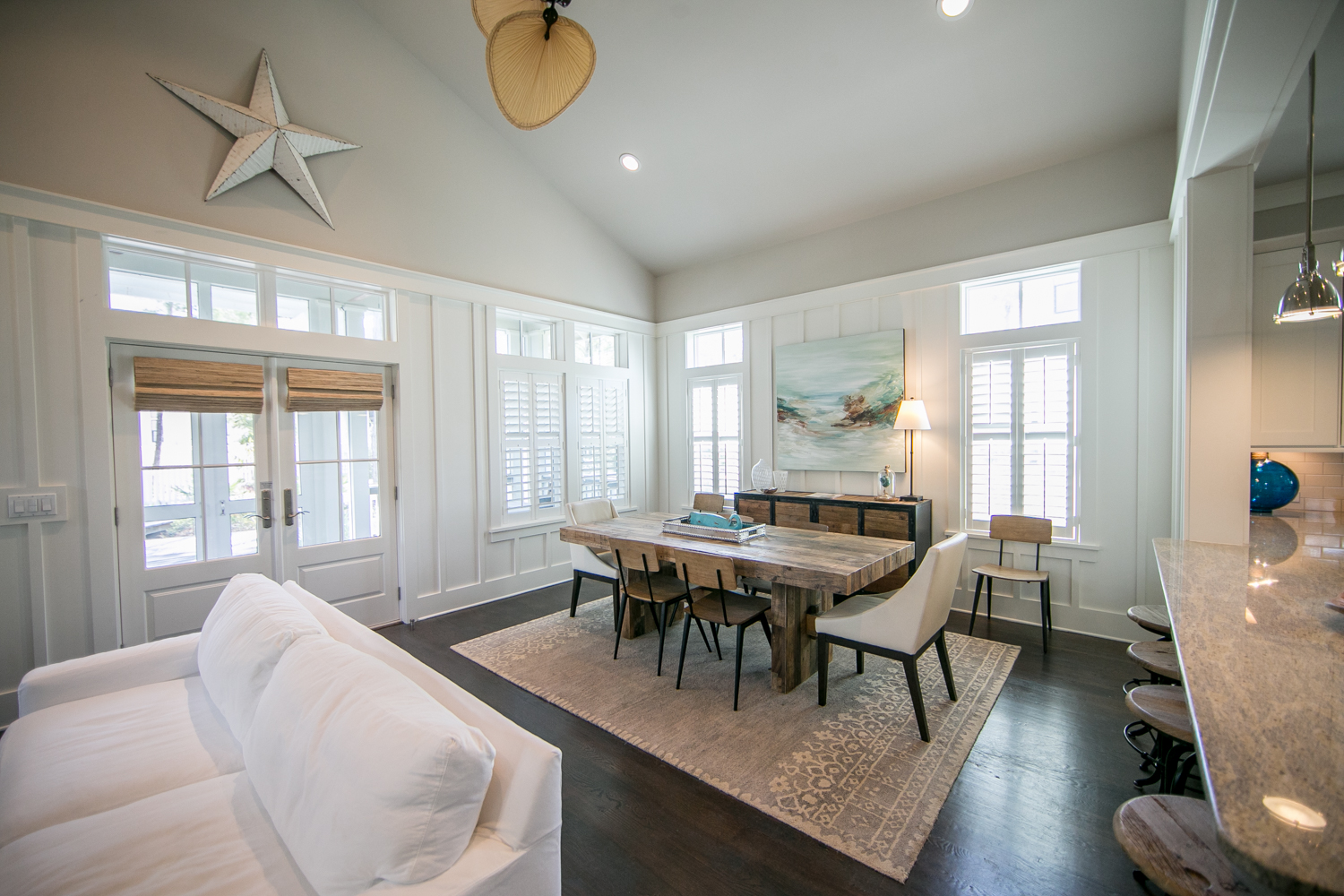 Open concept with doors that lead out to the screened-in patio