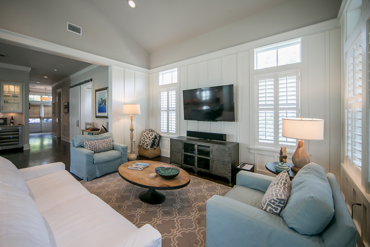 Vaulted ceiling living space with plenty of very comfortable seating for TV viewing or entertaining