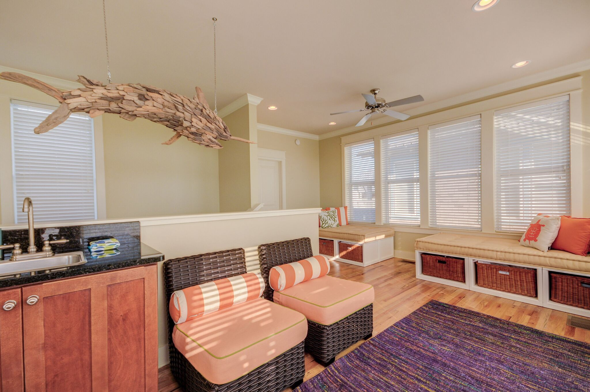Nice gaming area for the kids with wet bar and seating on 3rd floor