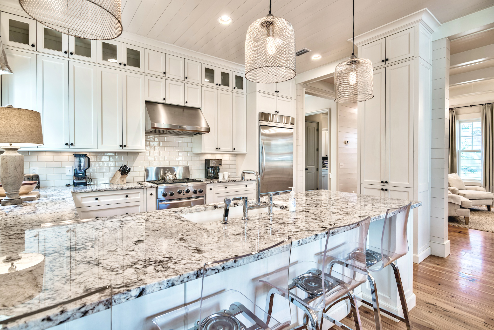 Beautiful granite counters accented by the creamy, white cabinets