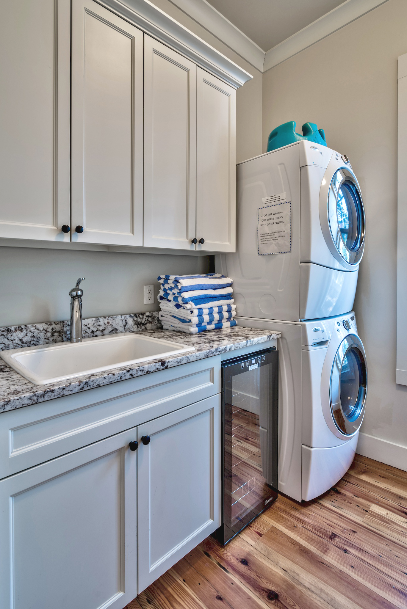 Large Laundry Room with Front Load Washer and Dryer