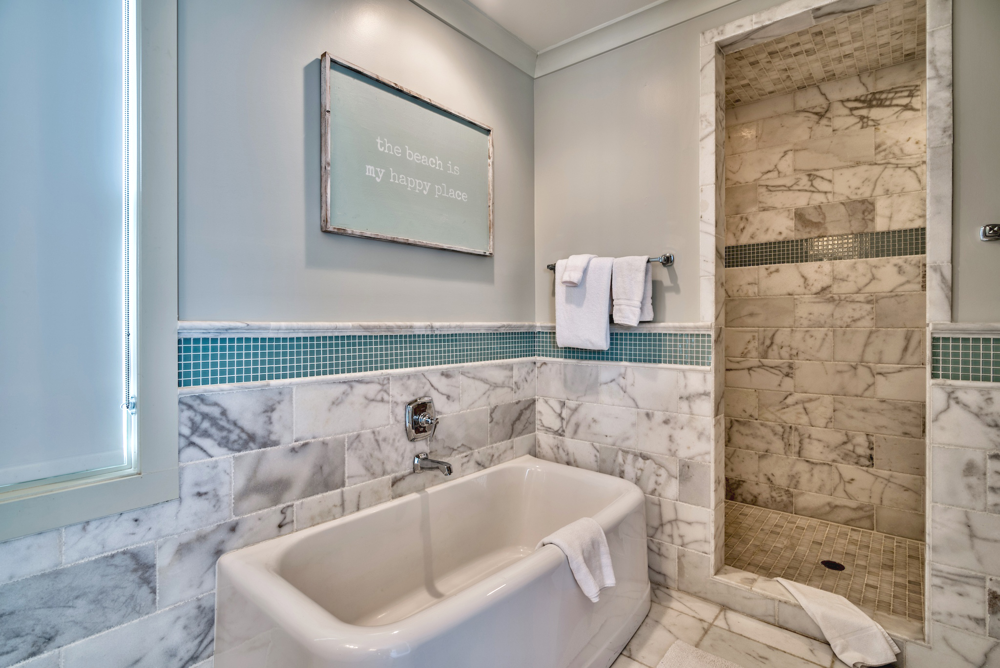 Master bathroom with a soaking tub and separate shower