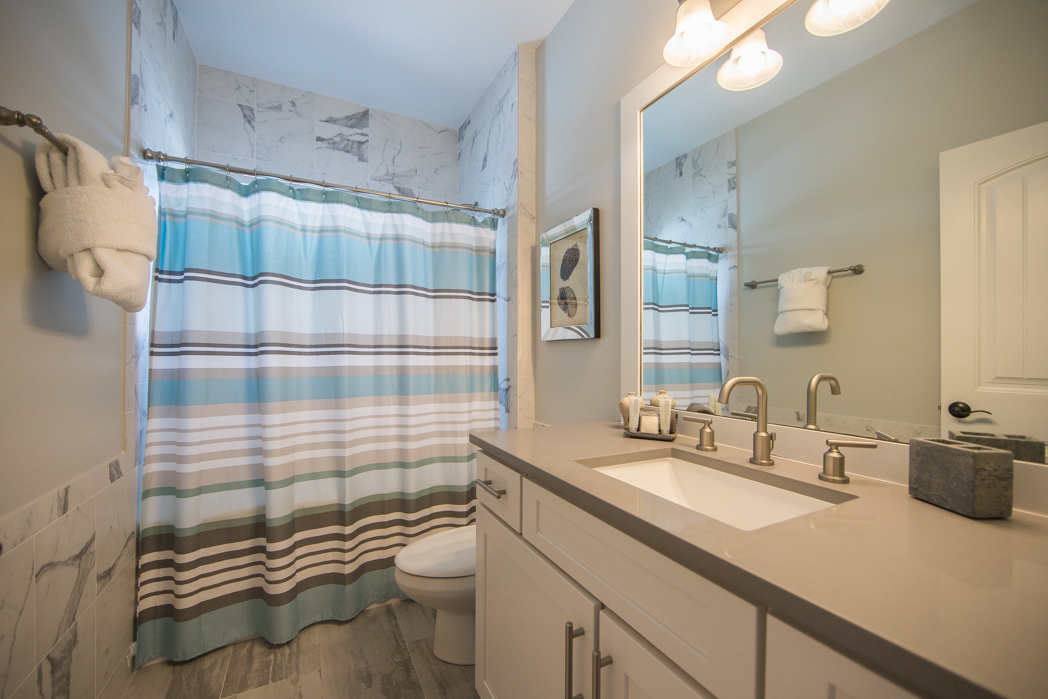 1st Floor Full Bath with Tub/Shower, Granite and Marble Finishes,  Adjacent to Bunk Room and Living Area.