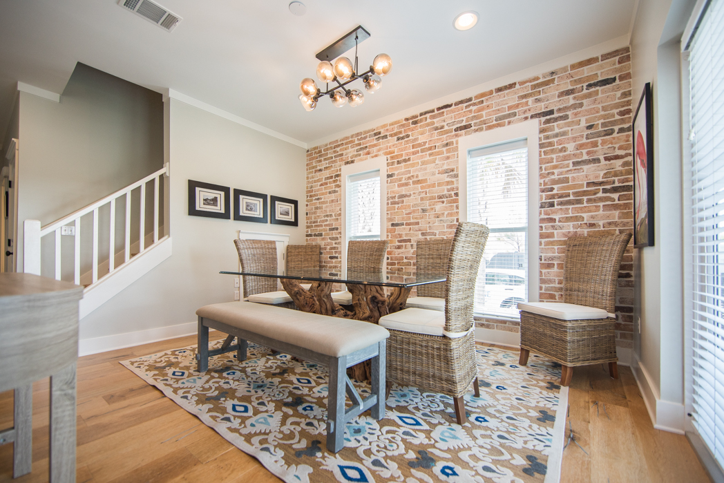 Cute dining area with custom brick accent and seating for 8 or more