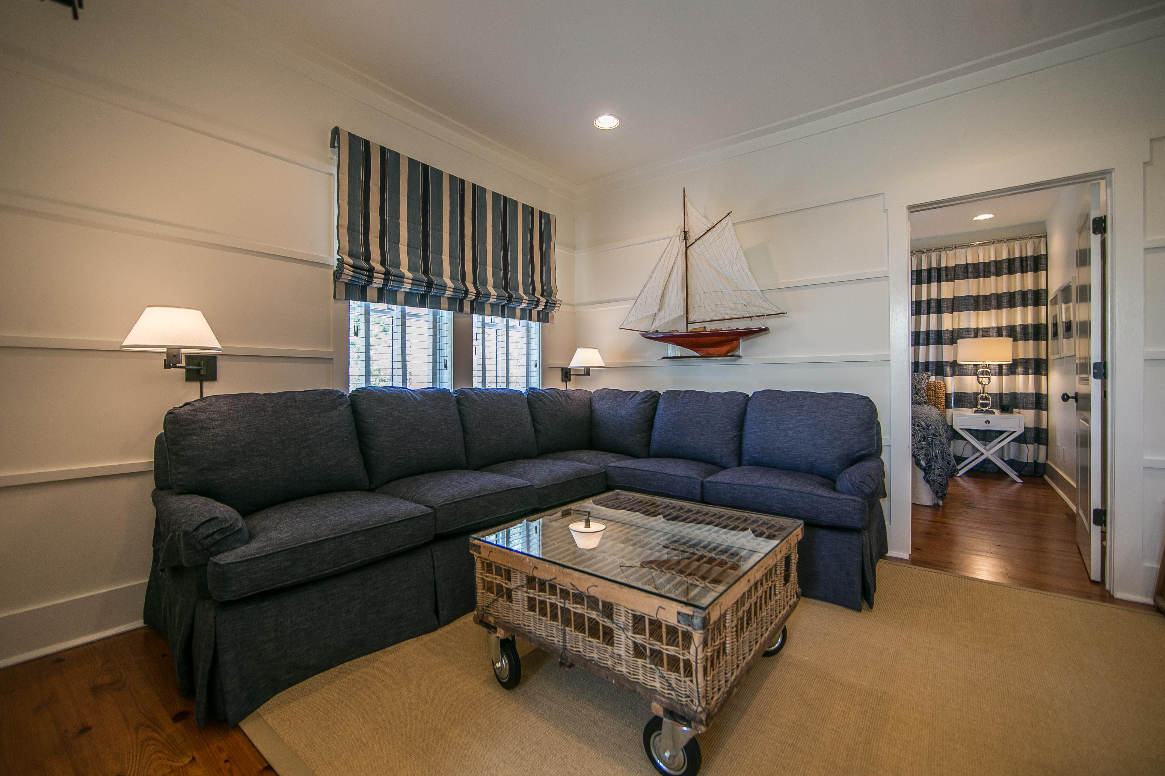 Fantastic living area at the top of the stairs with a sectional sofa and a large TV