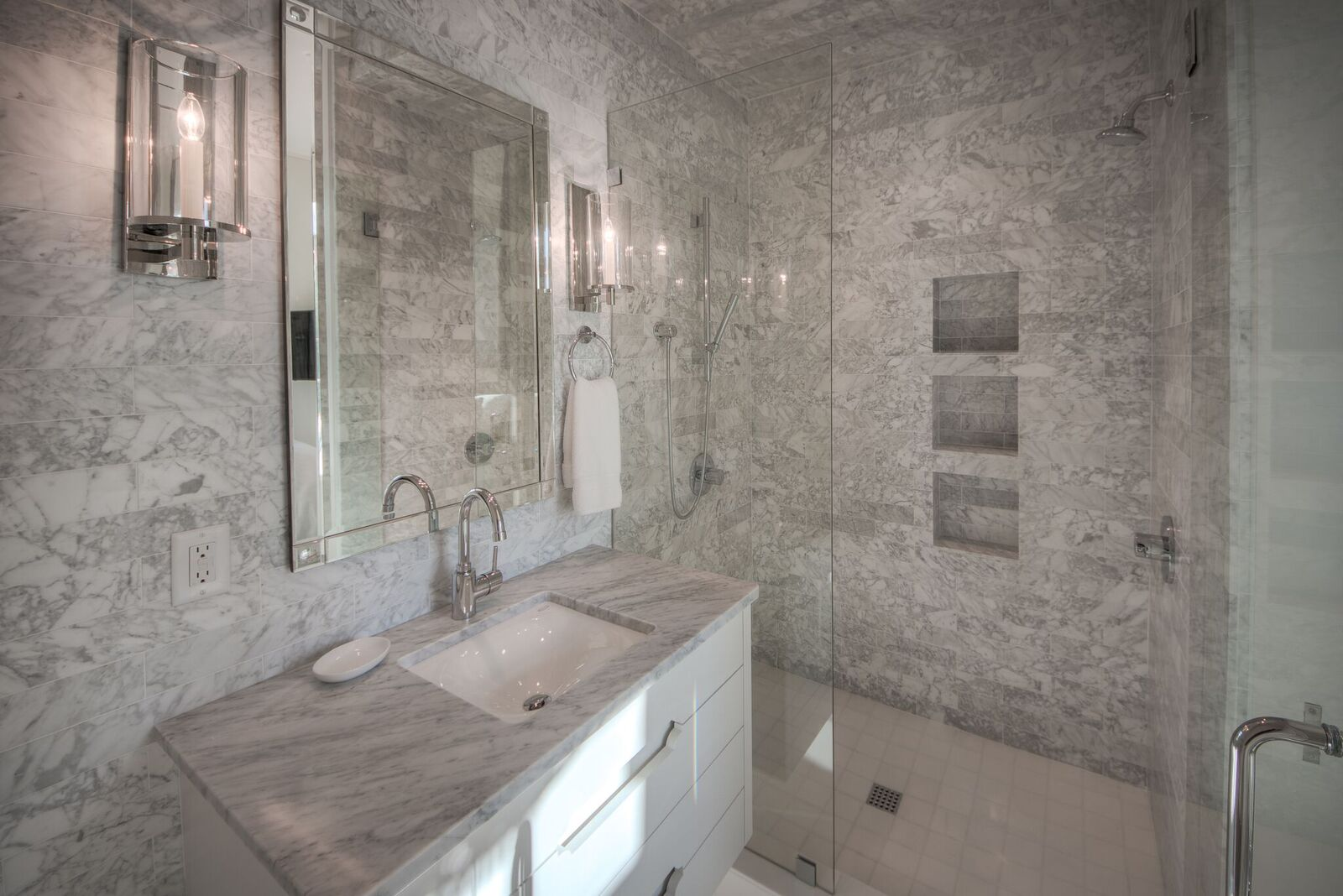 Ensuite bathrooms with walk-in showers for each bedroom