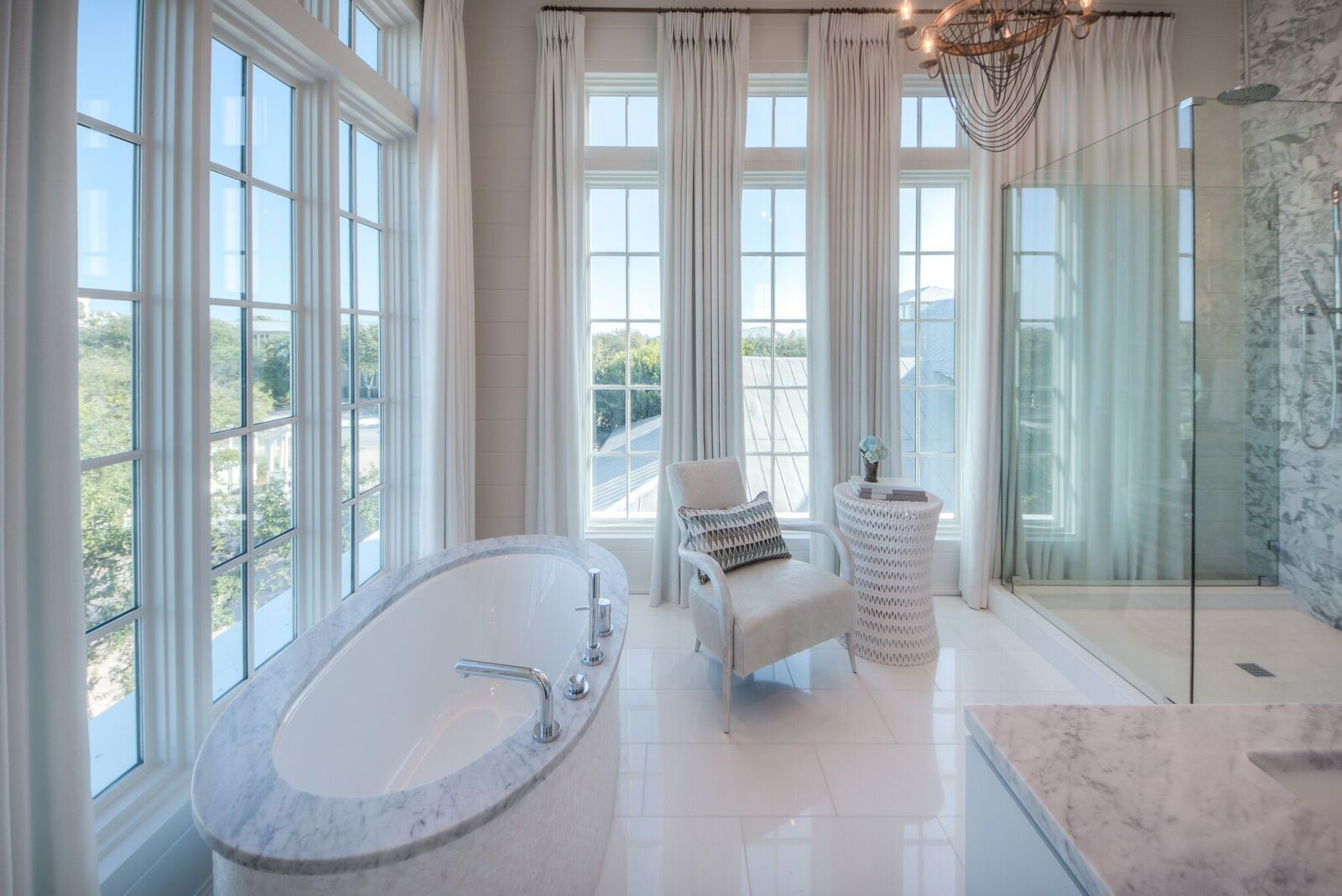 Master ensuite bathroom with soaking tub, large glass walk-in shower, dual vanities and private comode