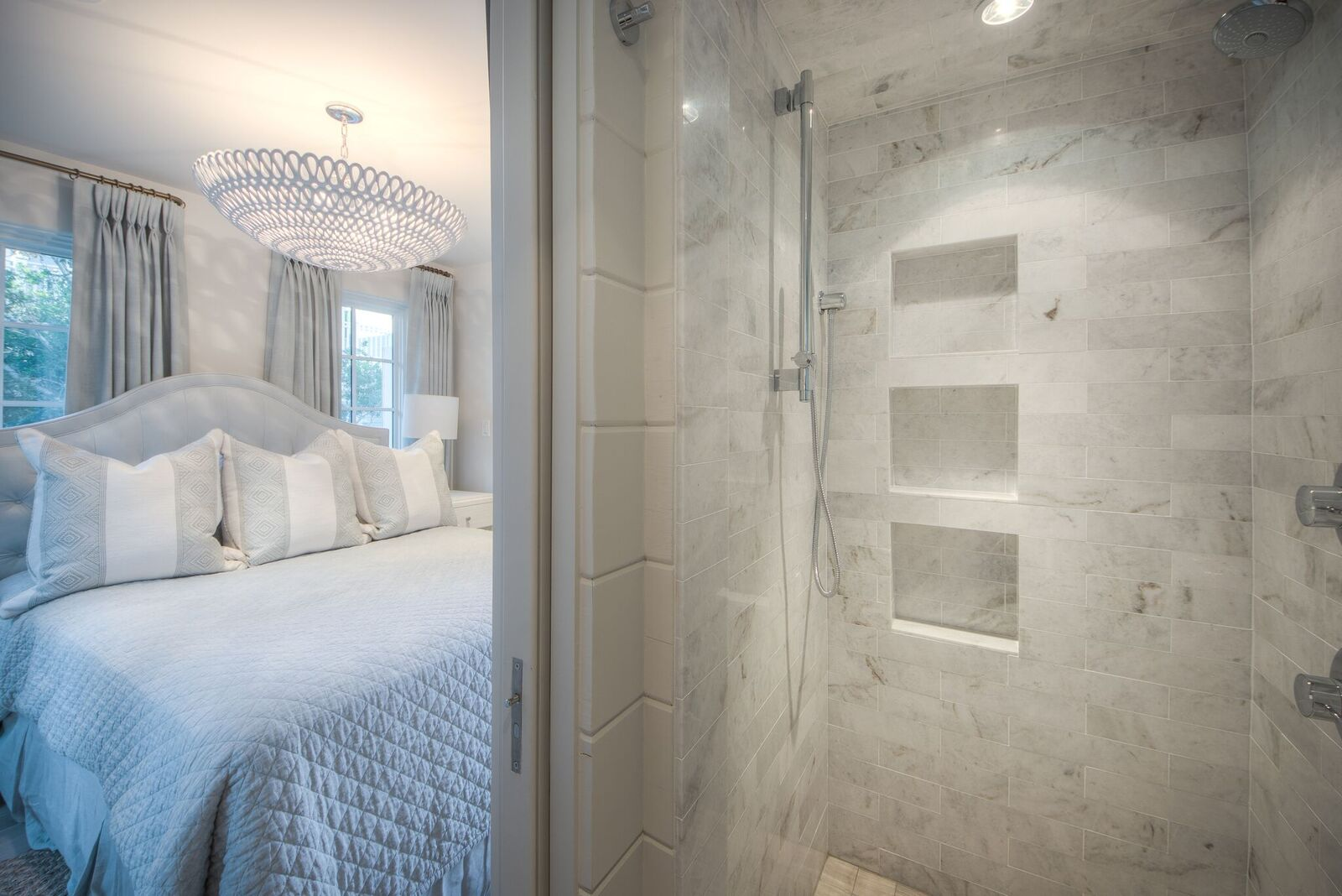 Queen bedroom with vanity in room and large shower and toilet adjacent to it