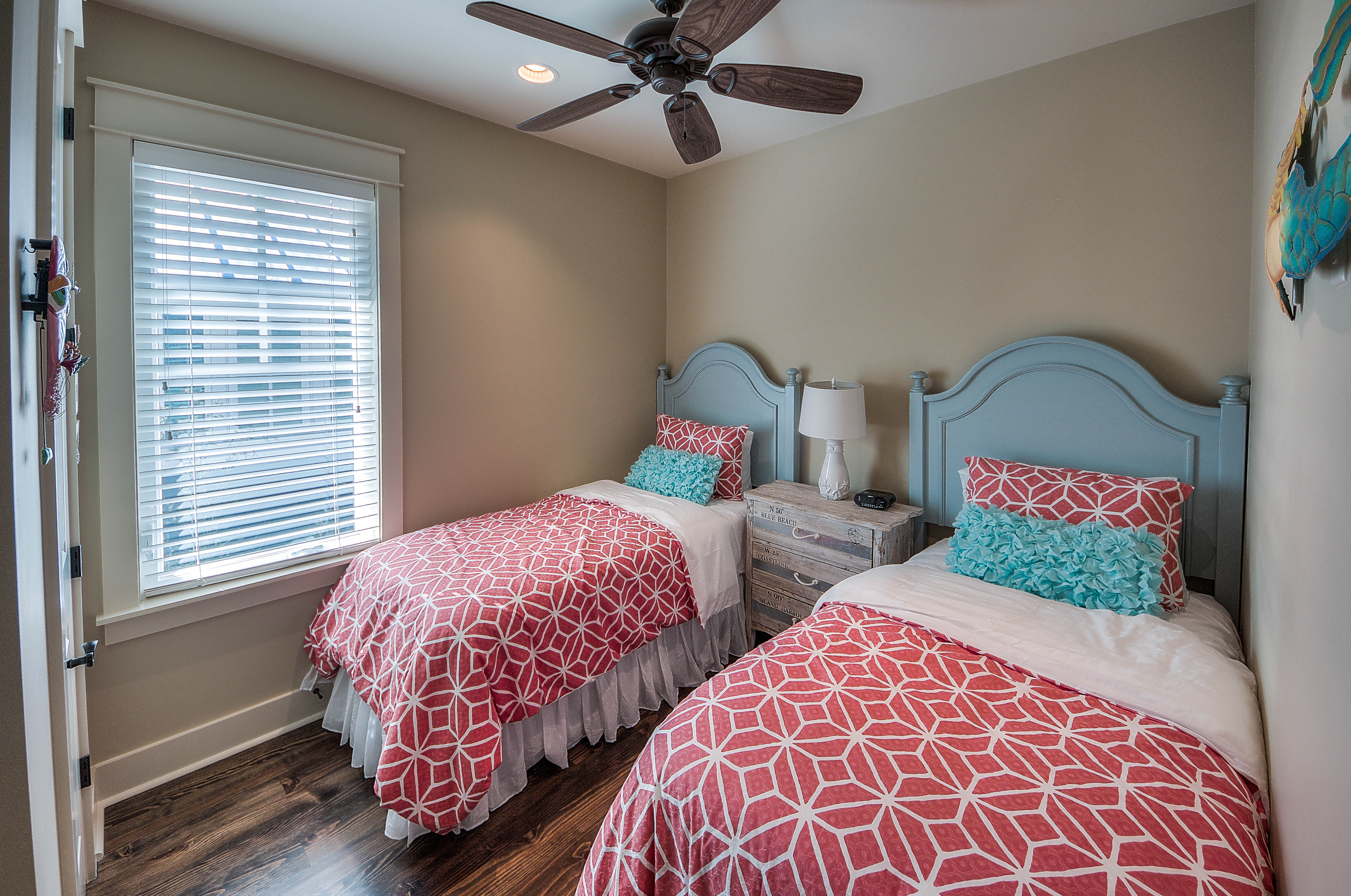 Adorable Twin bedroom at the top of stairs near seating area