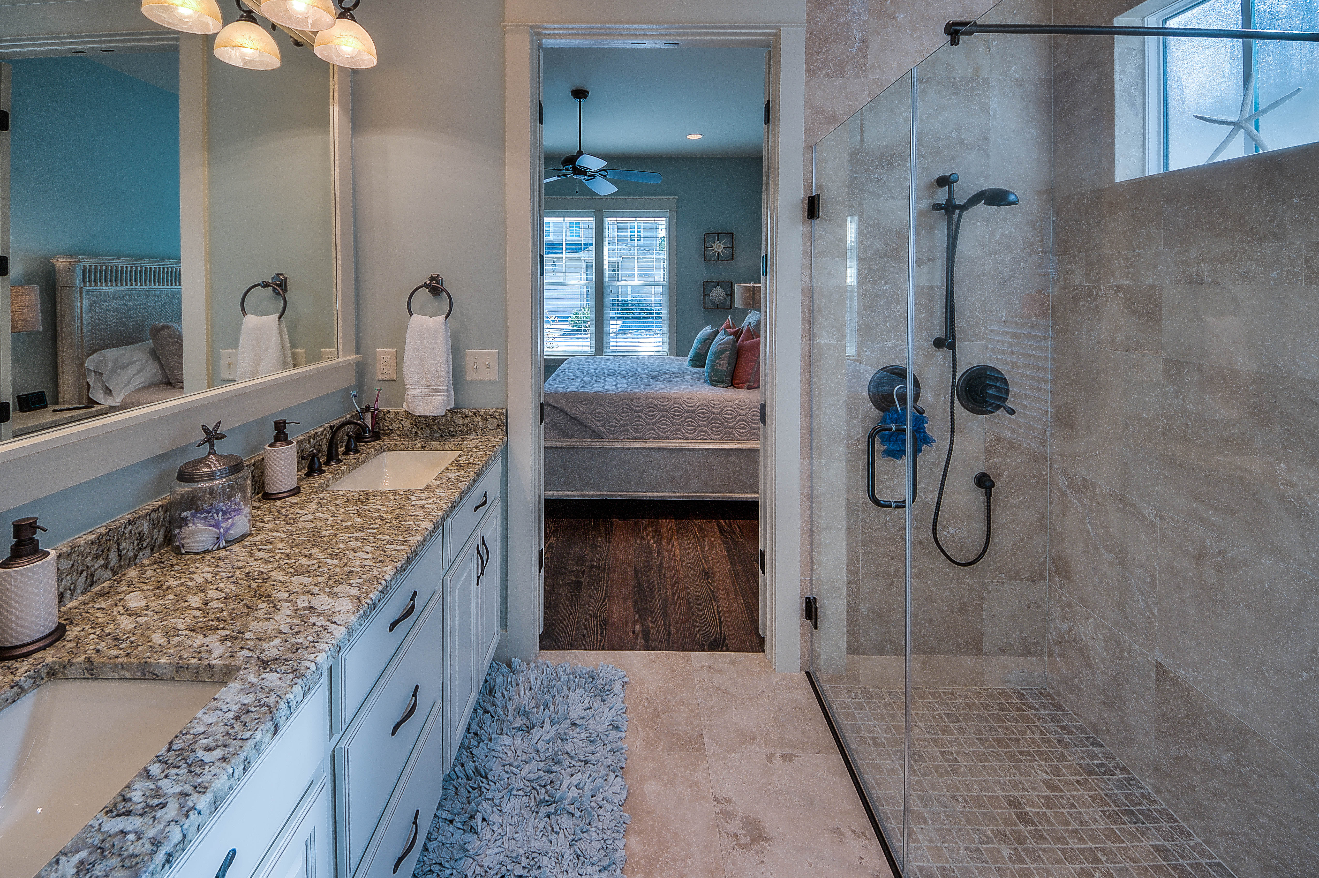 Limestone tile and granite counter tops with dual vanities and large walk-in closet in master bathroom