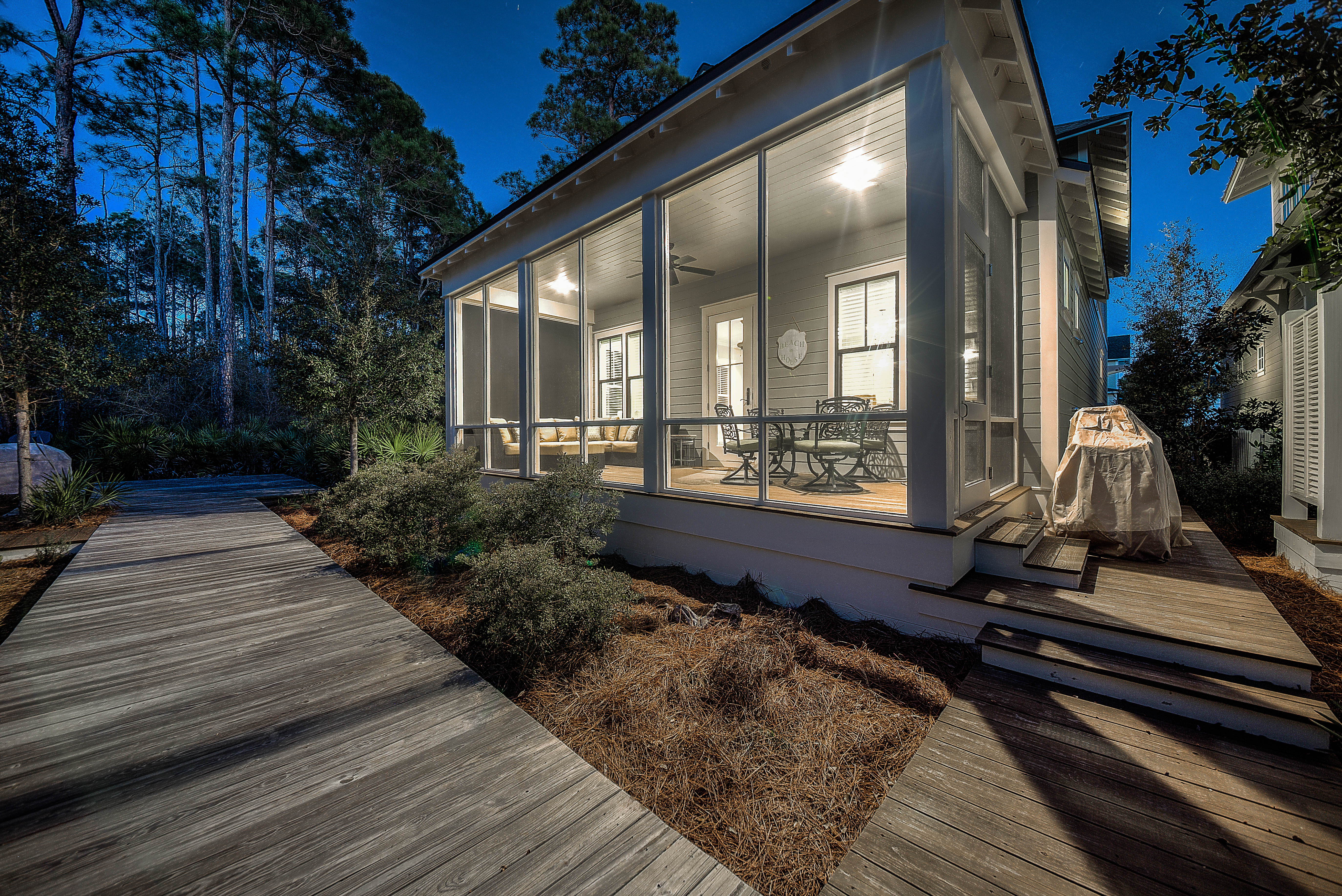 Walking paths surround the home and provide convenient access to the scenic lake and pool/beach access