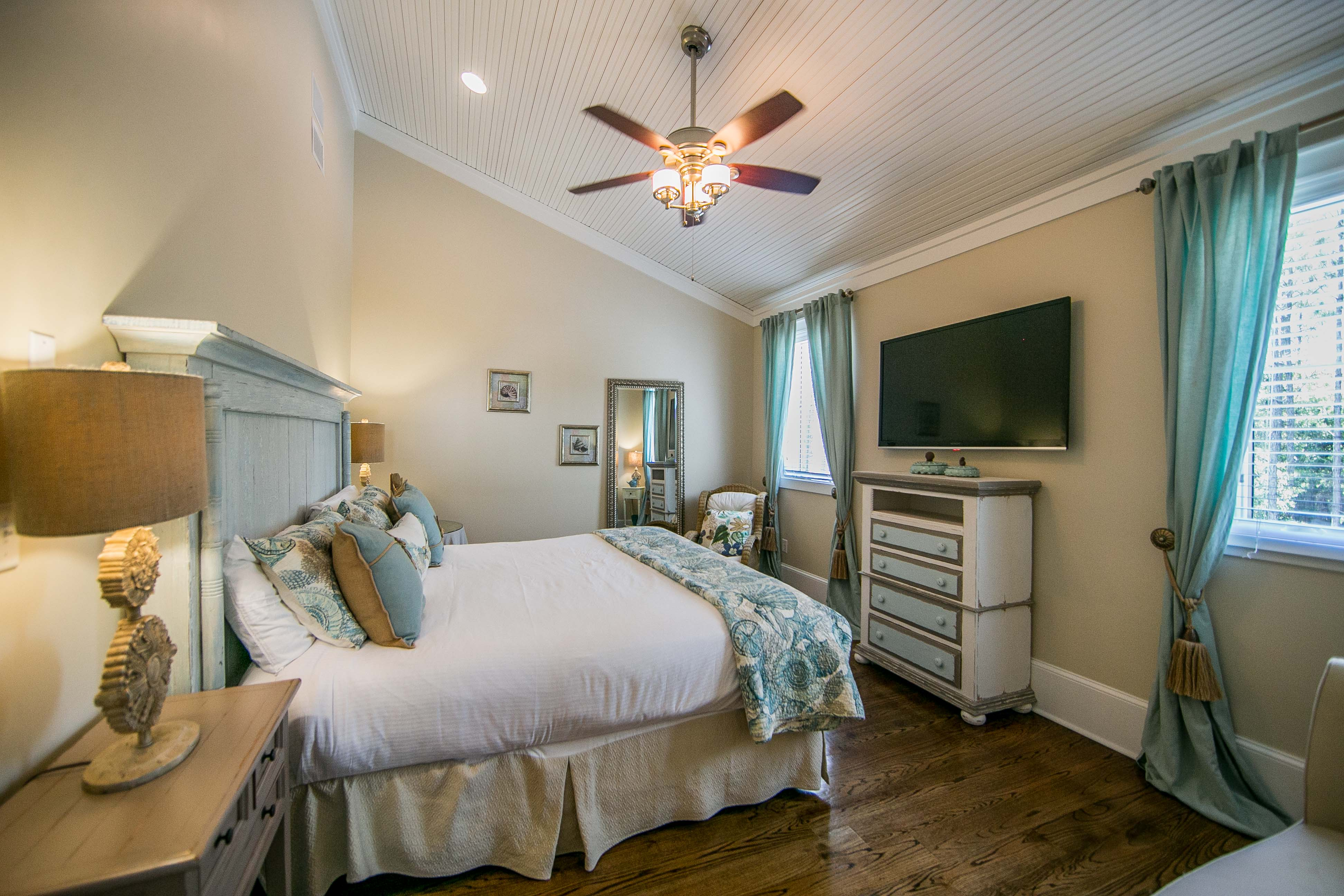 Bed facing private backyard and forest, large flatscreen TV
