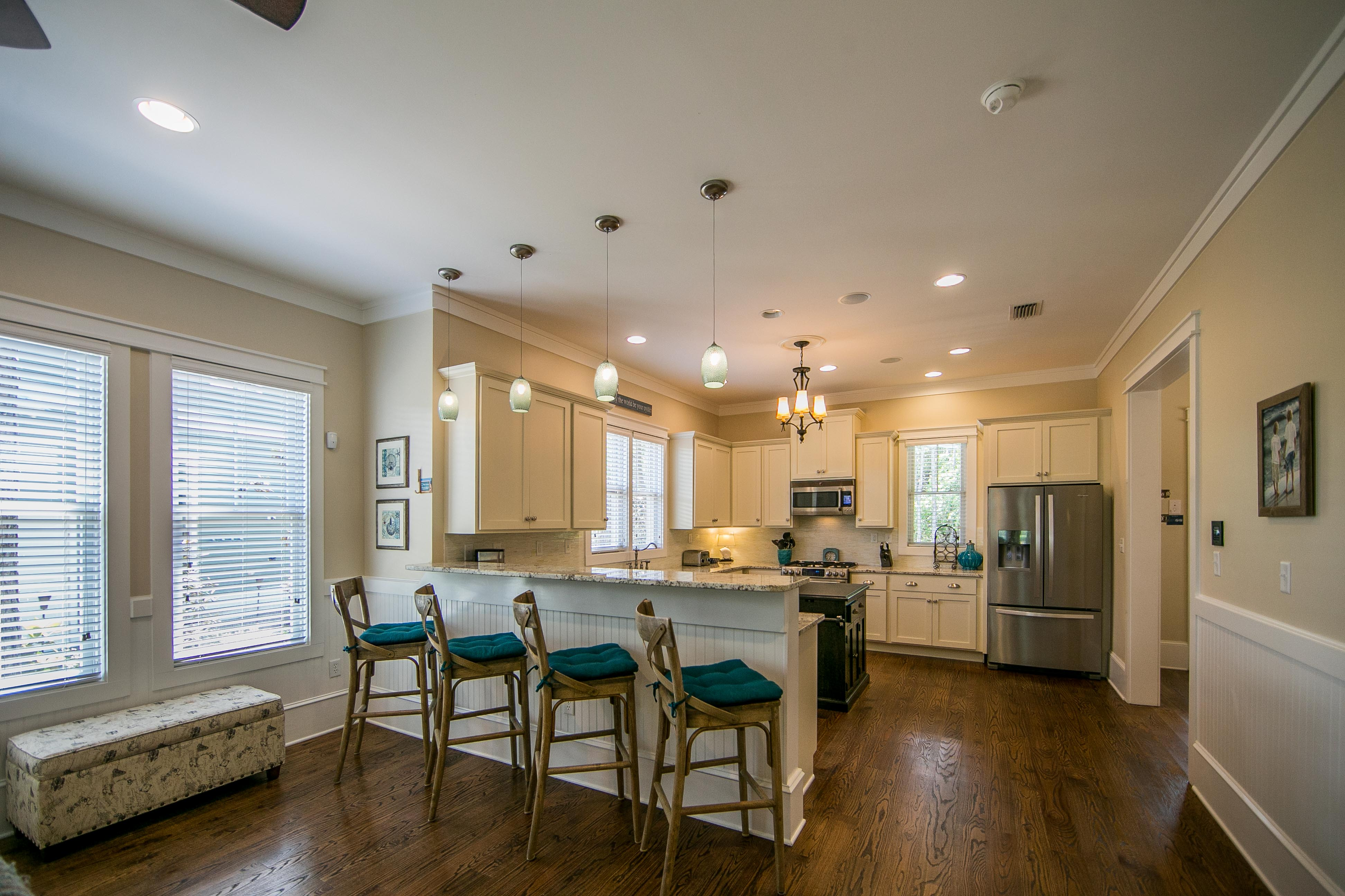 Bright open kitchen with barstool seating