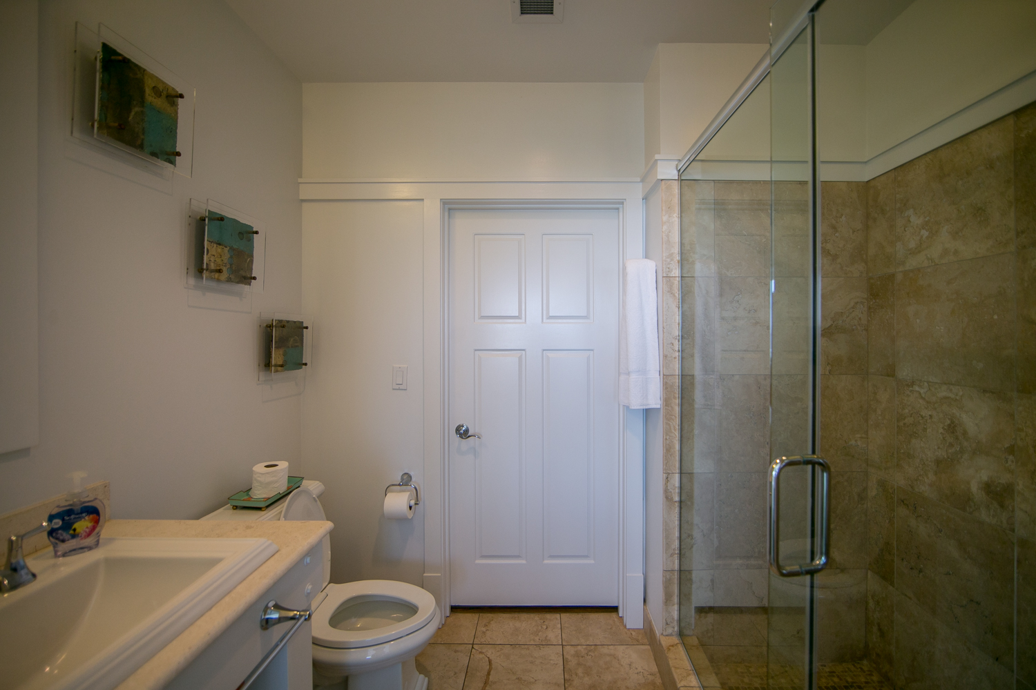 Bathroom with large walk-in shower off of second King Bedroom, also accessible by the hallway