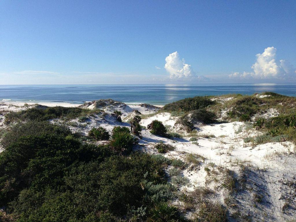 Breathtaking views of the tranquil rolling dunes and gulf, walking paths throughout