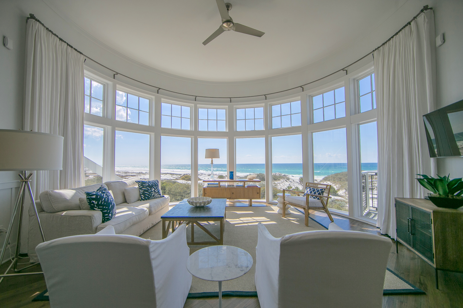 Gorgeous living room rotunda with high ceilings frame the most spectacular view of the Gulf