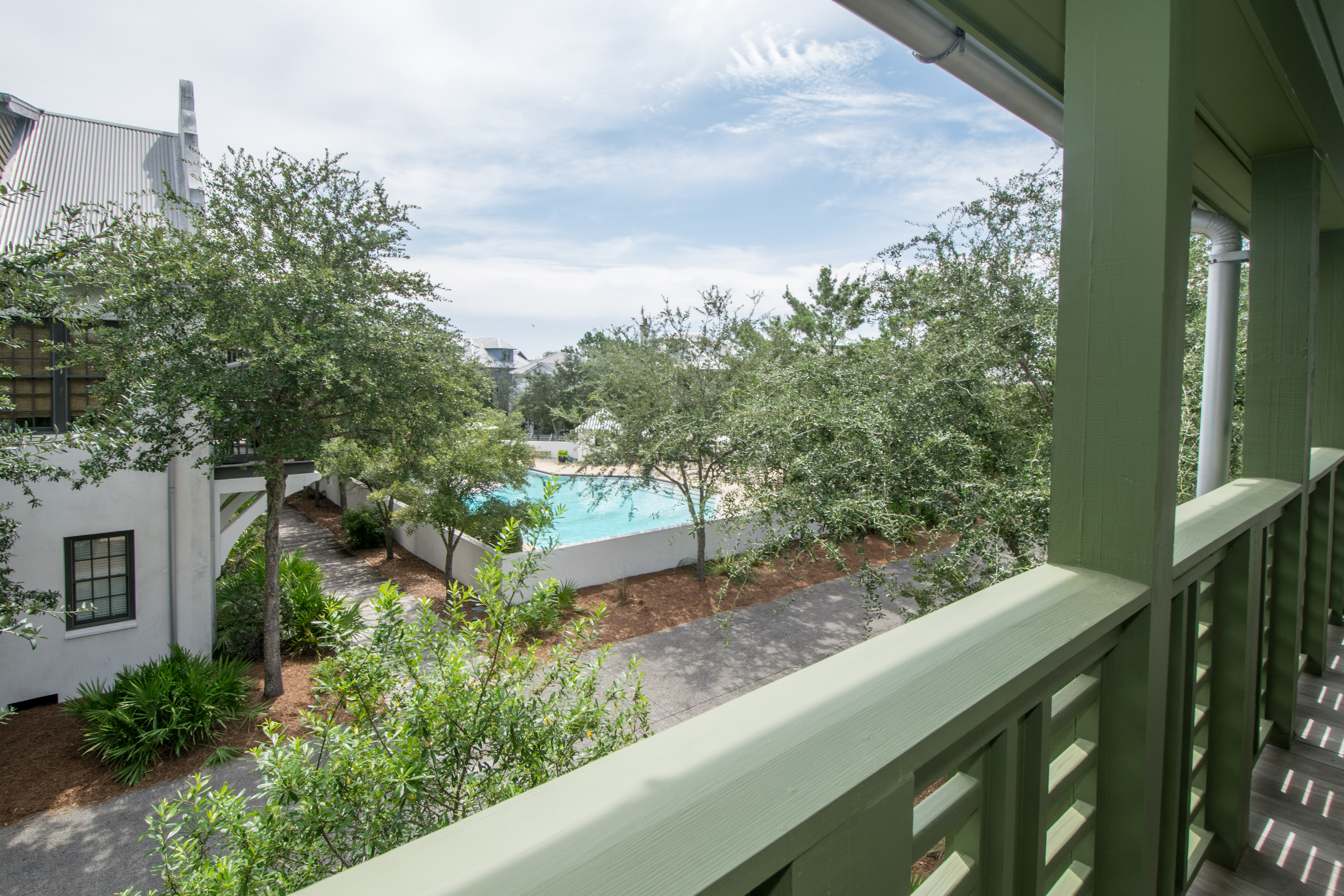 Deck off of Master Bedroom overlooking Rosemary's Cabana Community Pool