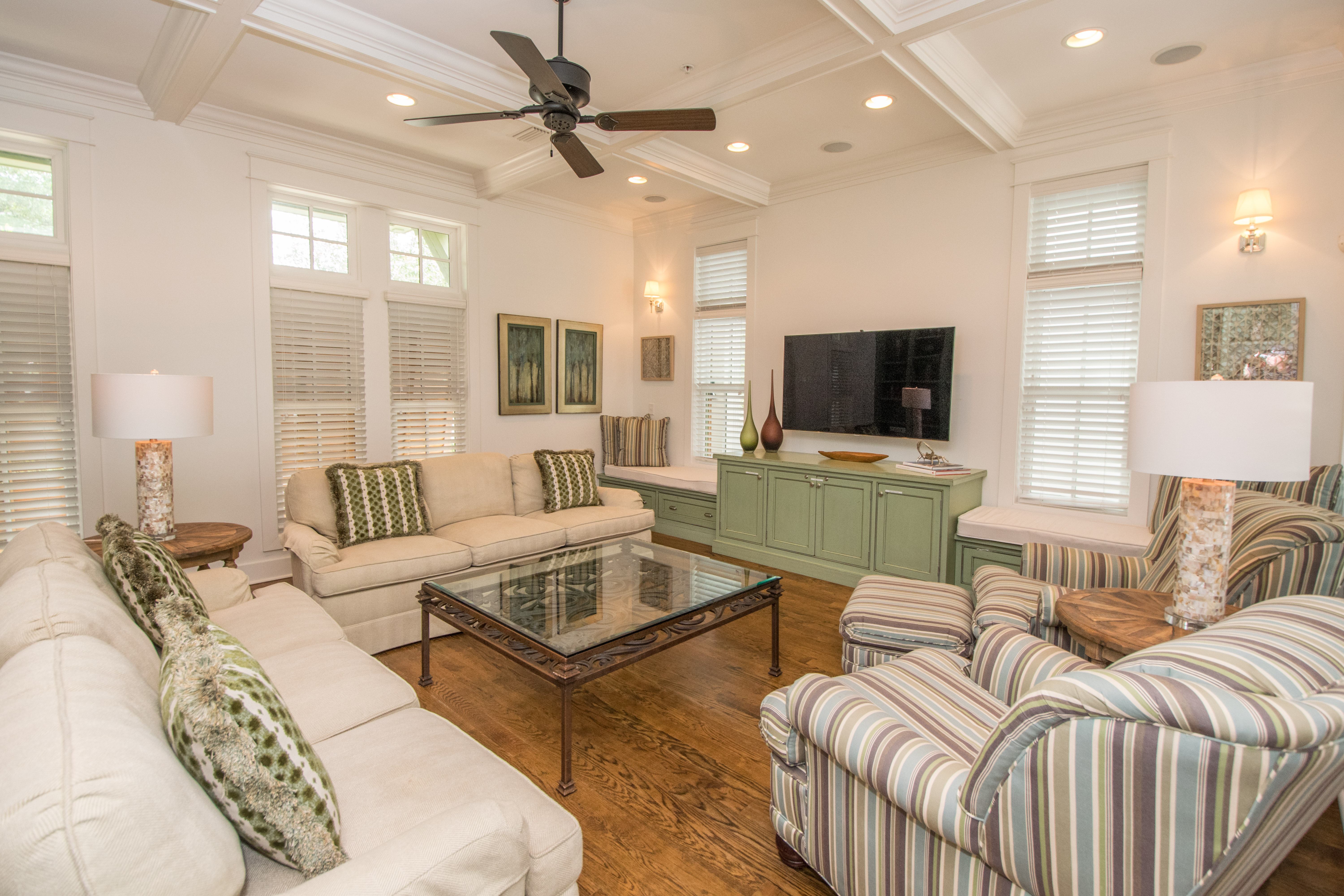 Family room is bright and spacious and has a 55 inch flat screen tv