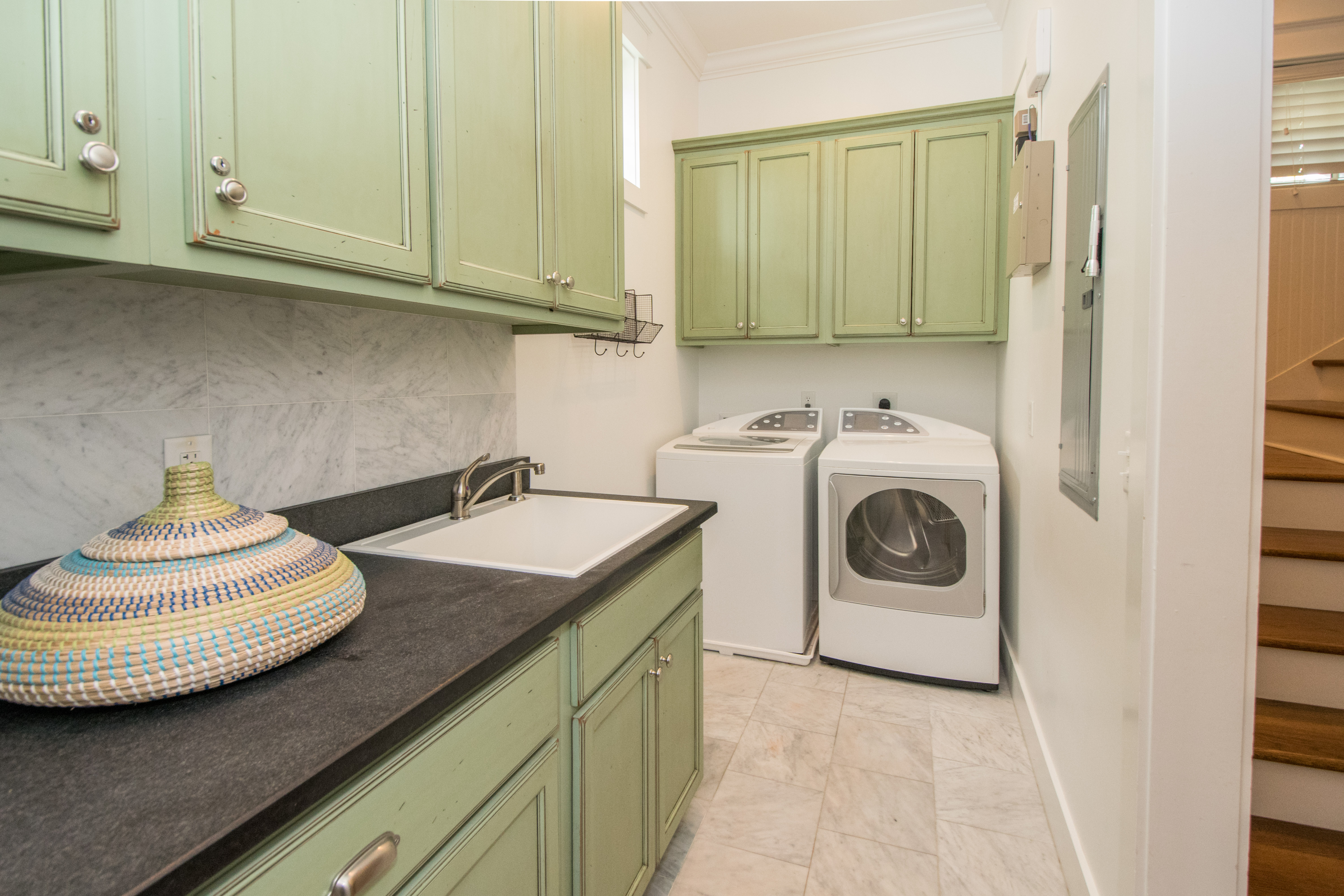 Laundry Room on 1st floor is perfect for dropping off those wet pool towels