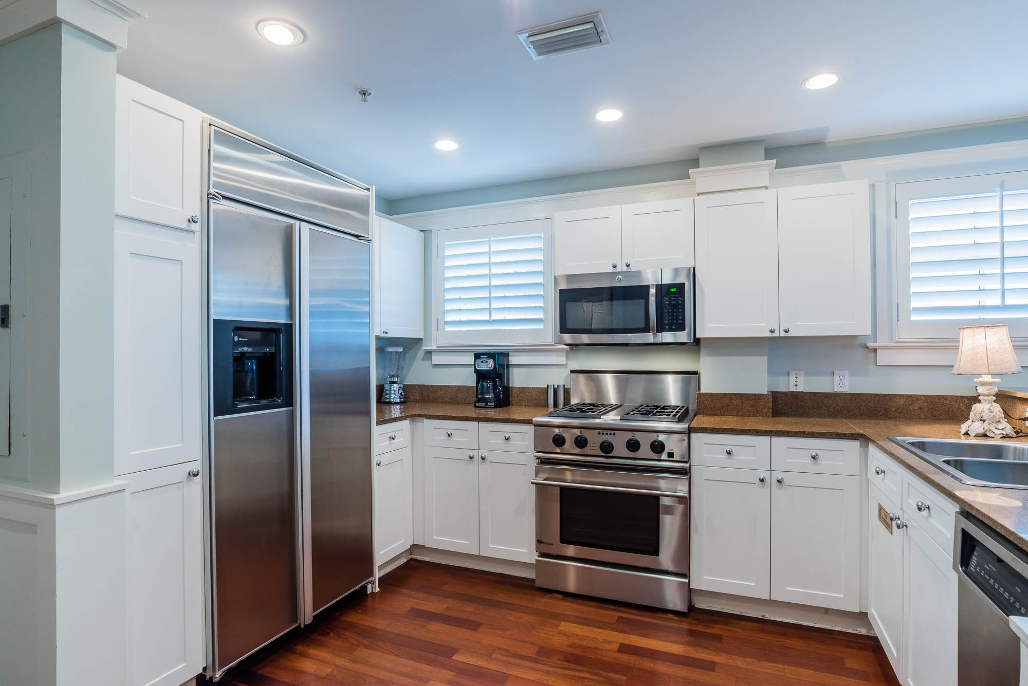 Kitchen with all stainless appliances and granite countertops