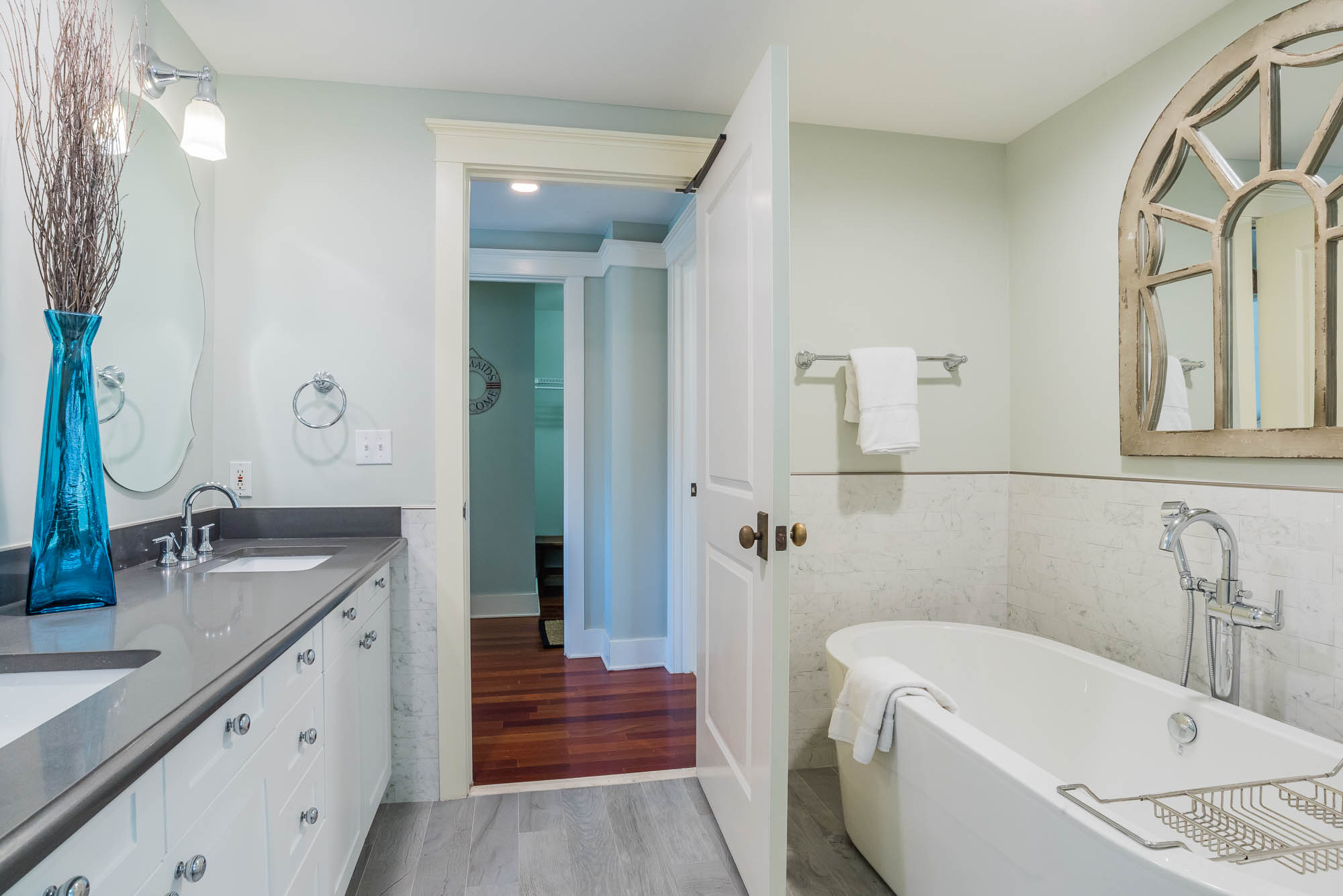 The master bath has a large, double vanity and a soaking tub