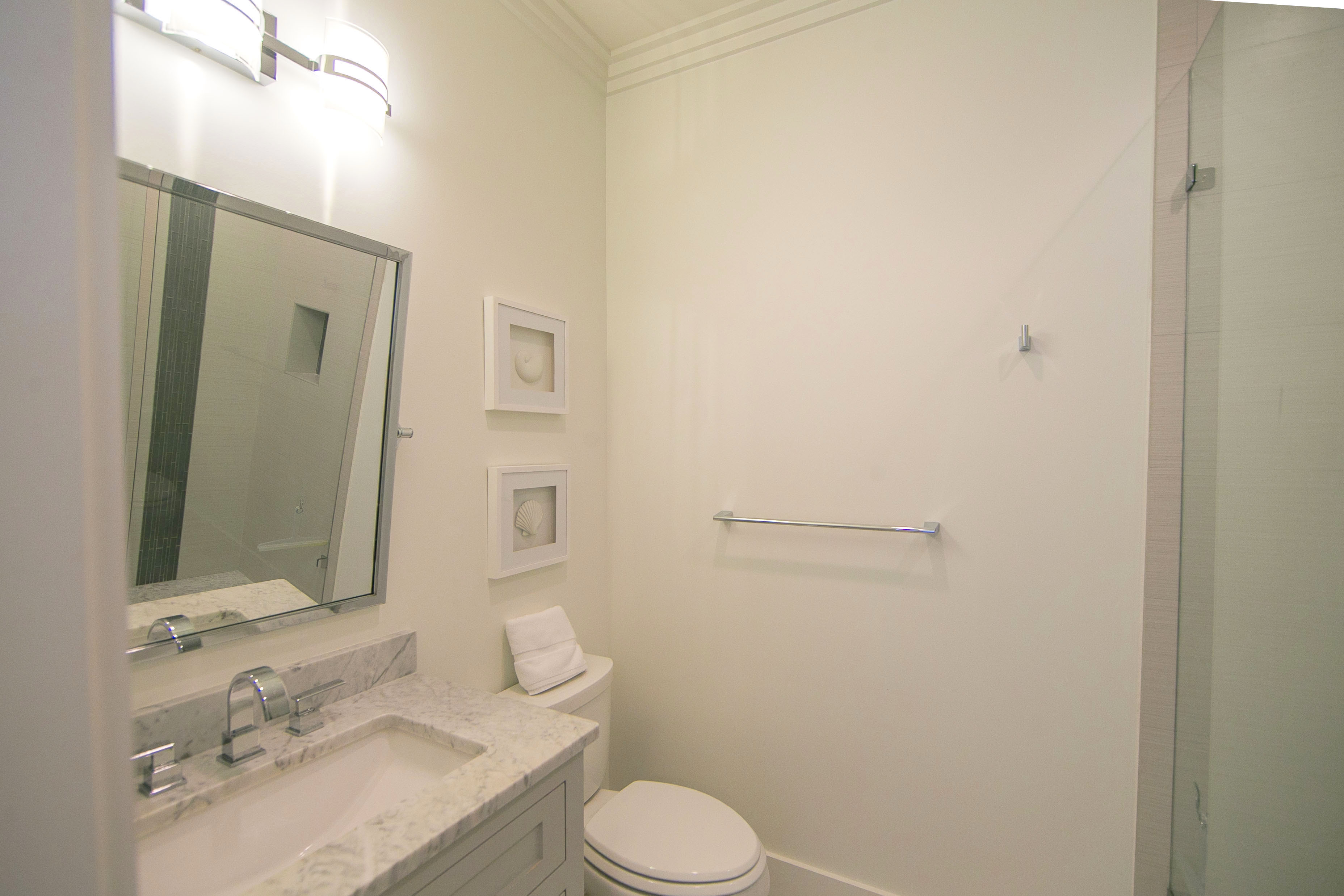 2nd floor king bedroom ensuite bath with a marble vanity and a shower.