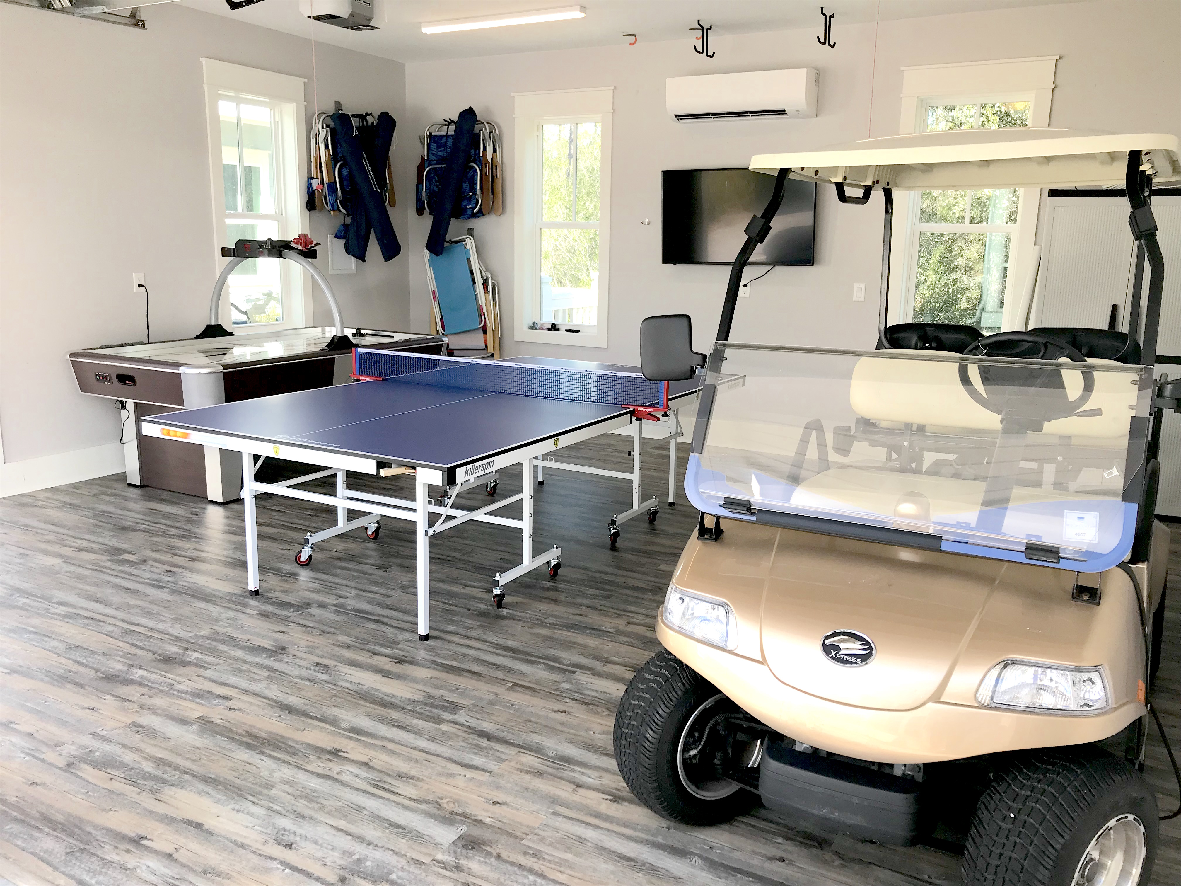The garage has been converted into an air conditioned game room with a ping pong table, air hockey and TV.  Golf cart is also located in the garage.