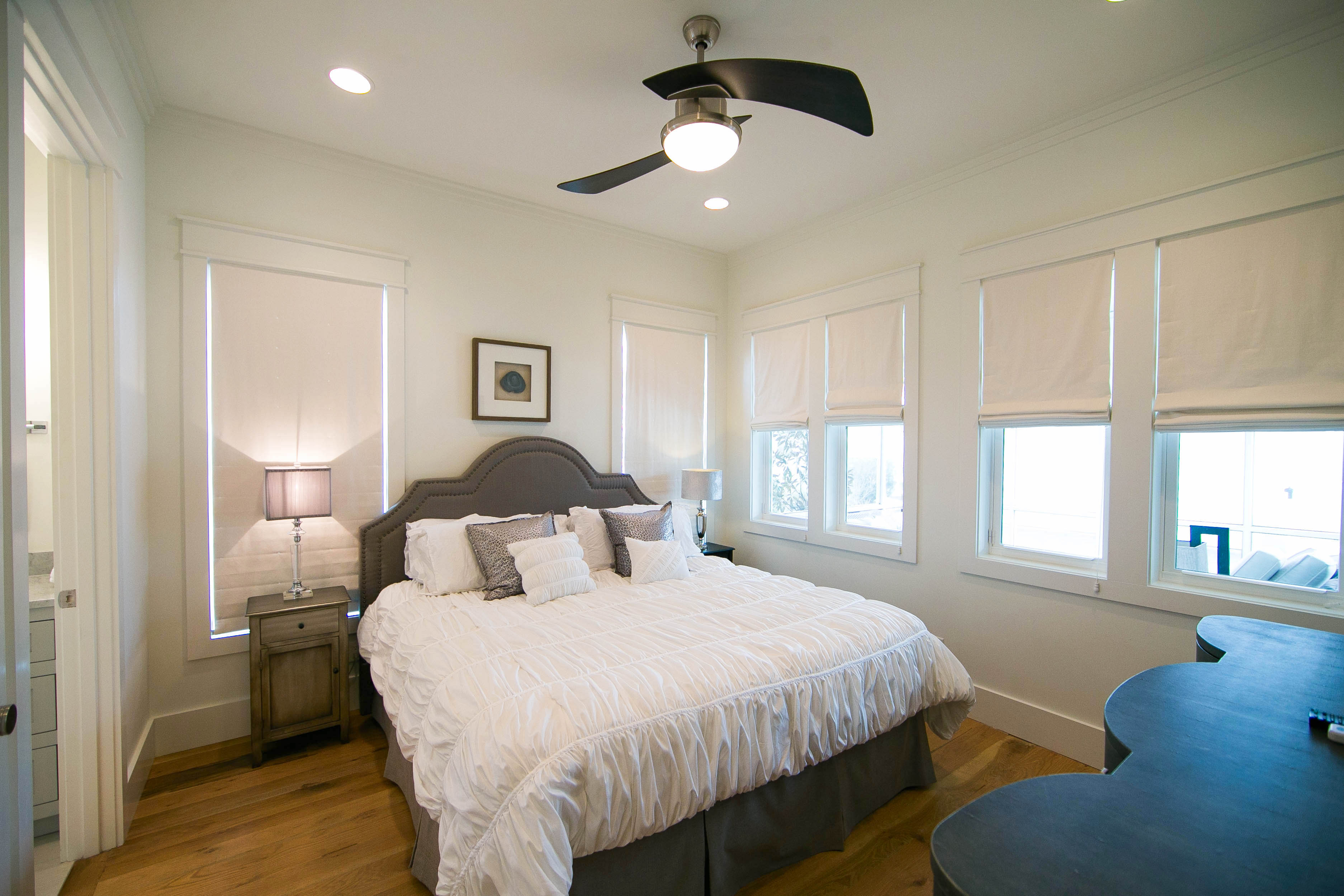 The second guest bedroom is on the first floor and has a king size bed and views of the pool.