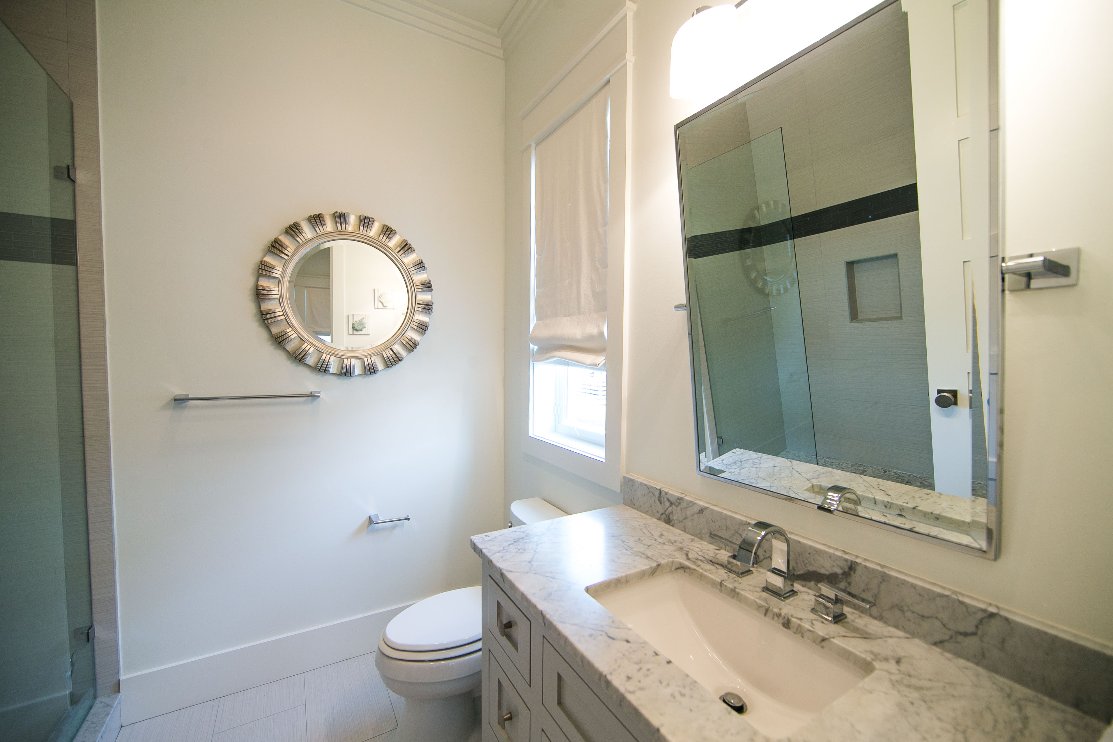 King guest bedroom ensuite bath with a marble vanity and a shower.