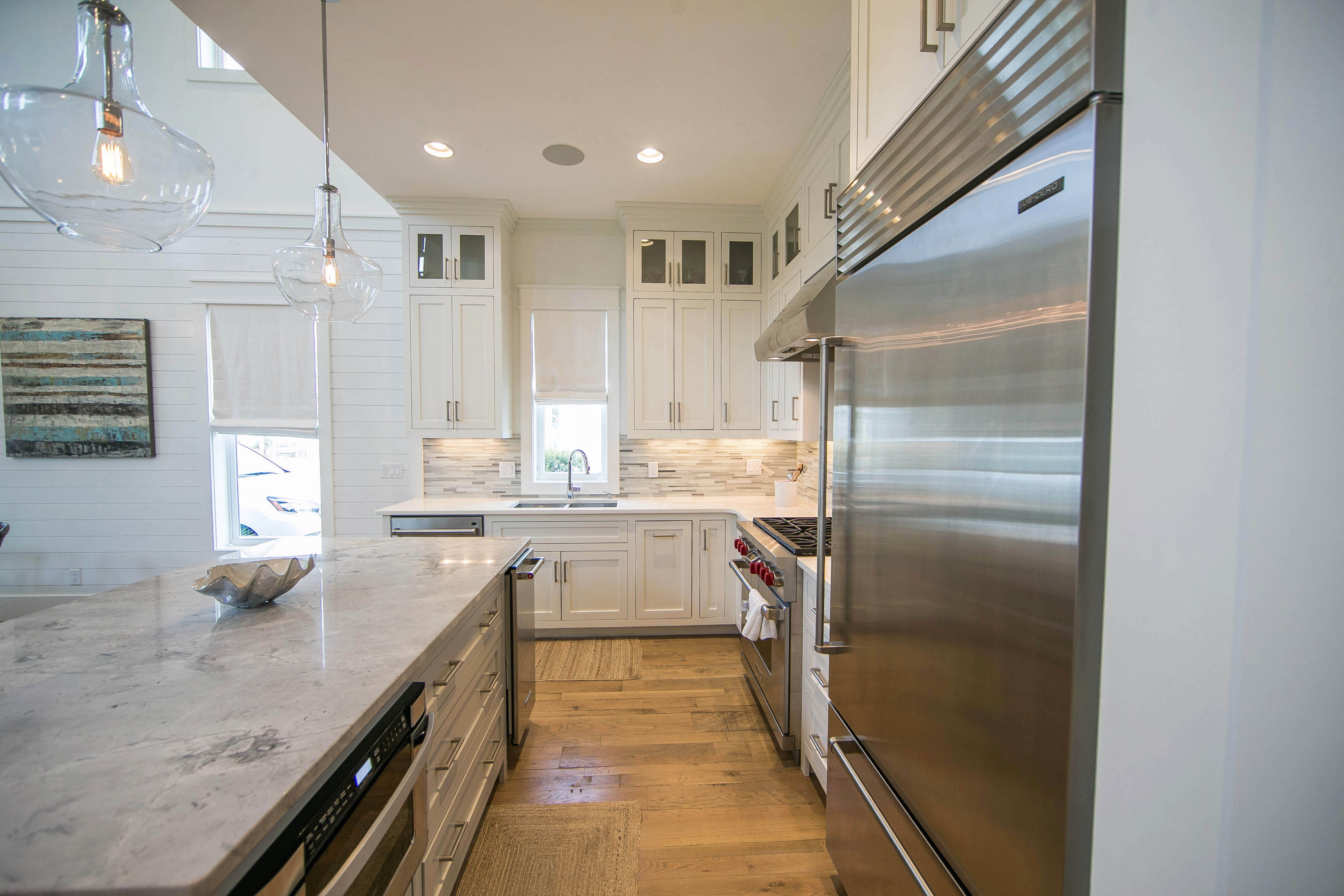 The kitchen is equipped with all stainless steel appliances.