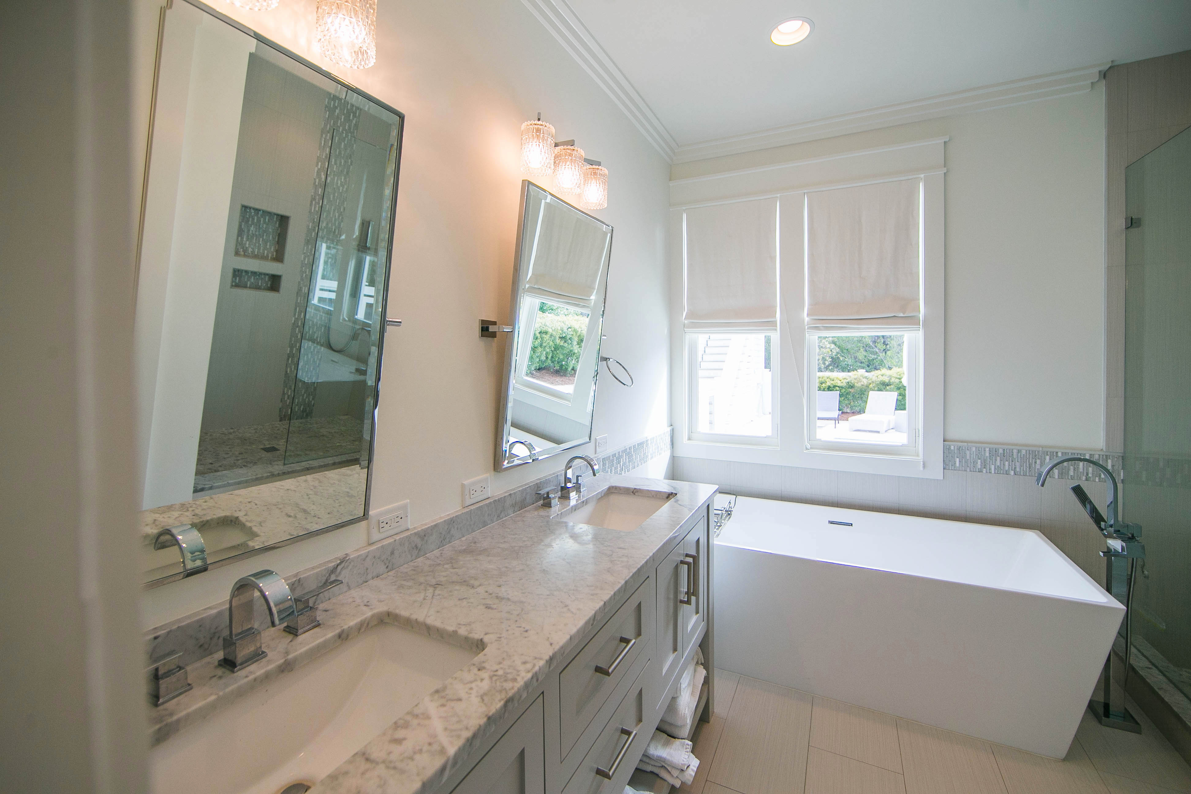 The master bathroom has a gorgeous double vanity and large soaking tub.