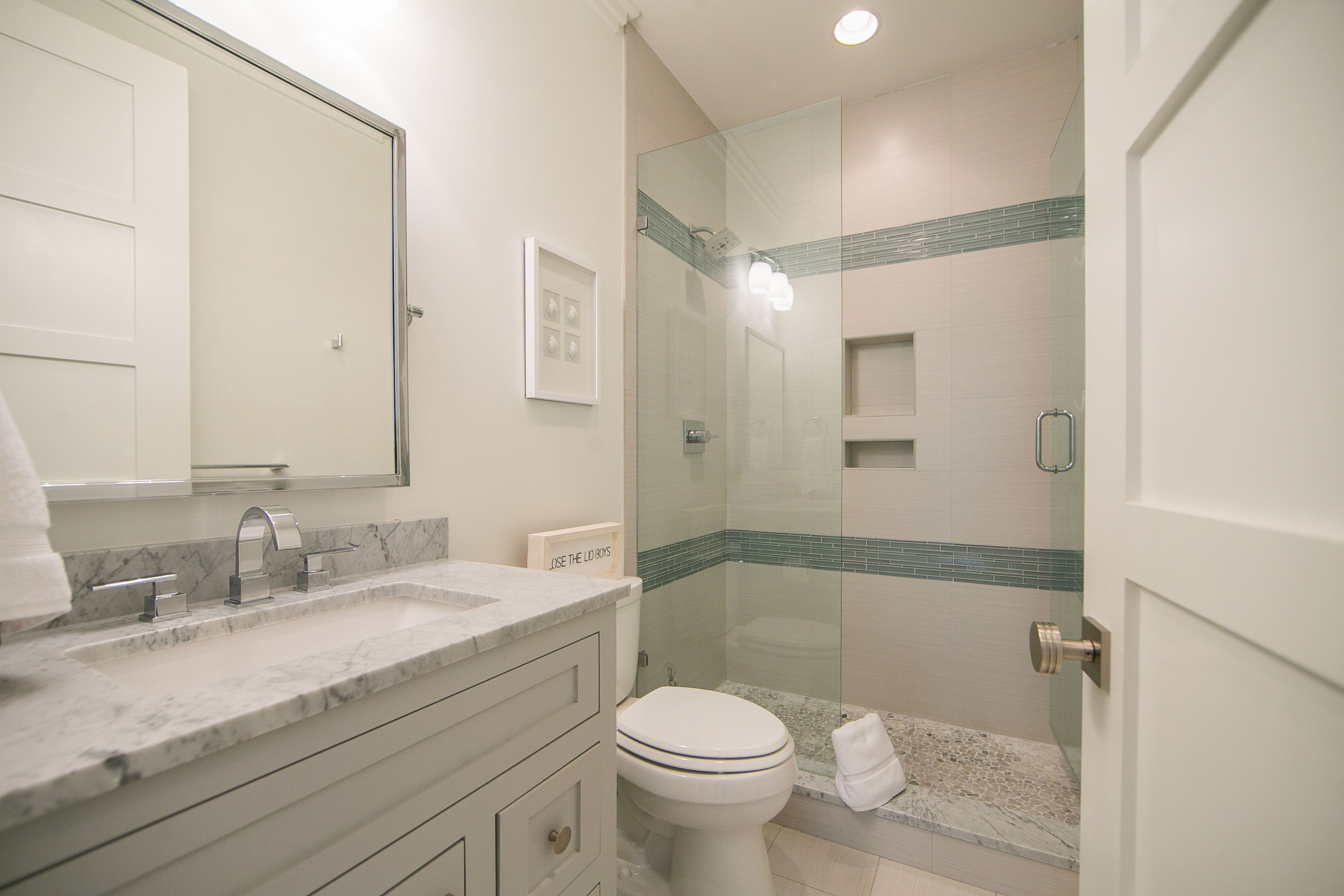 Shared hall bath on the 2nd floor with marble vanity and beautiful, custom tiled shower.