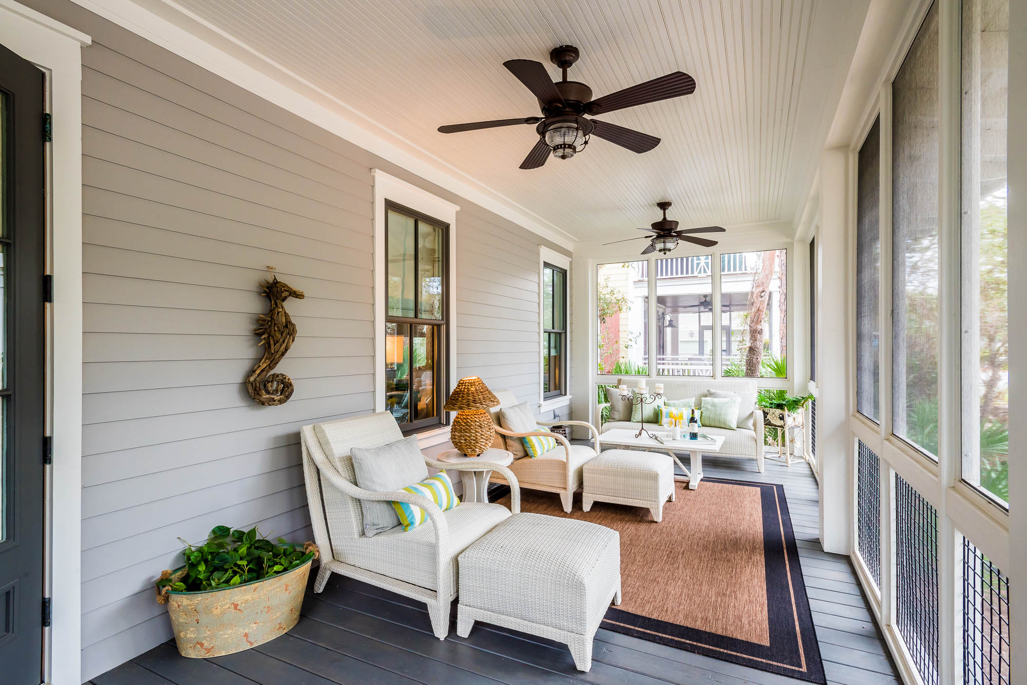Relax the day away inside the front screened porch