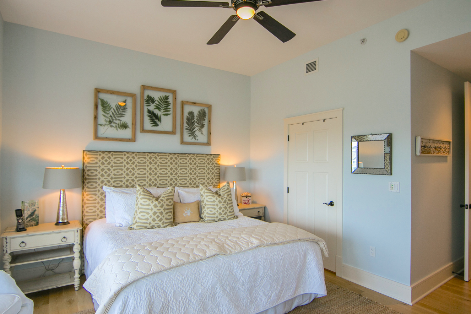 The king guest bedroom features an attached bath