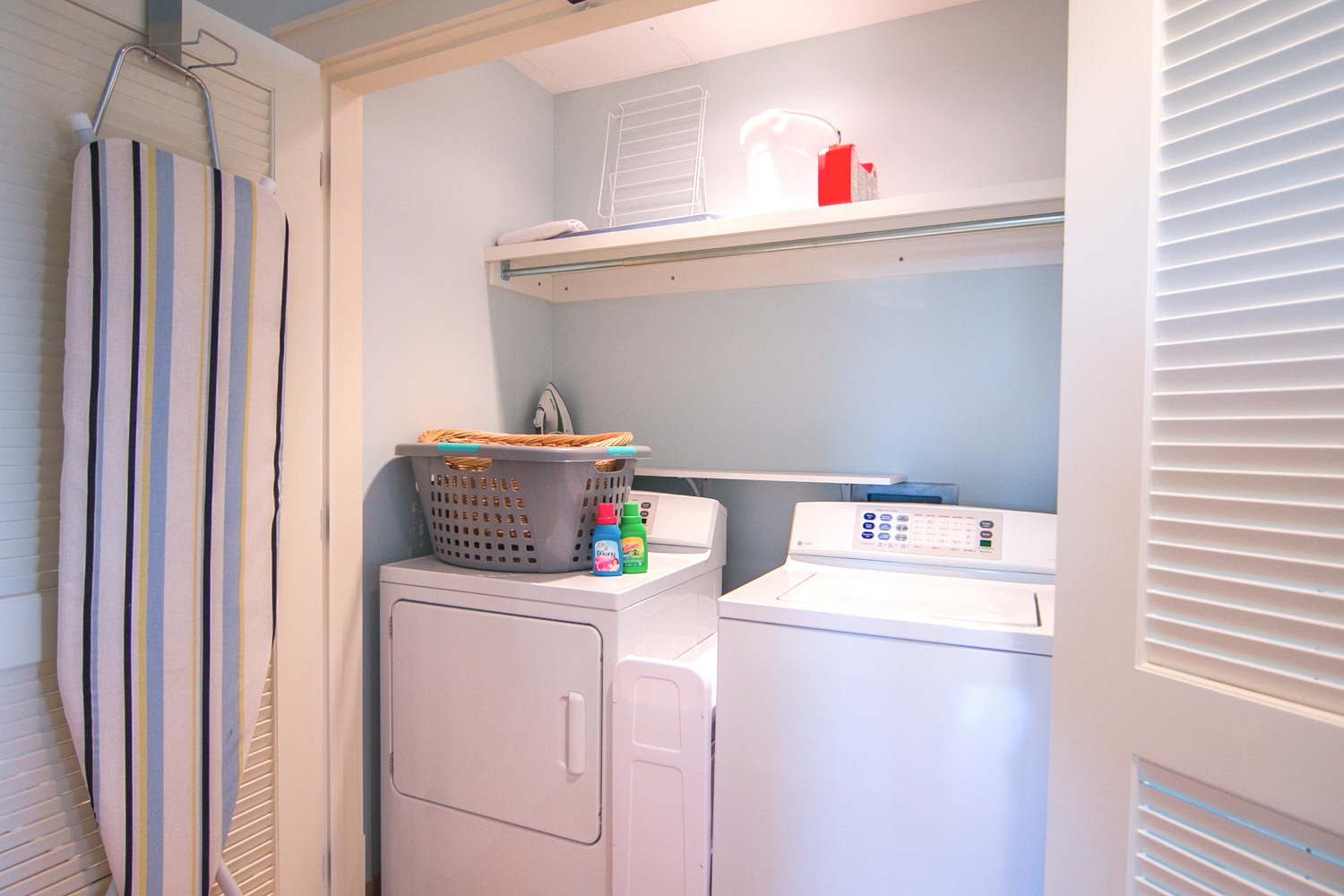 Laundry area is located in the hallway leading to the guest bedrooms