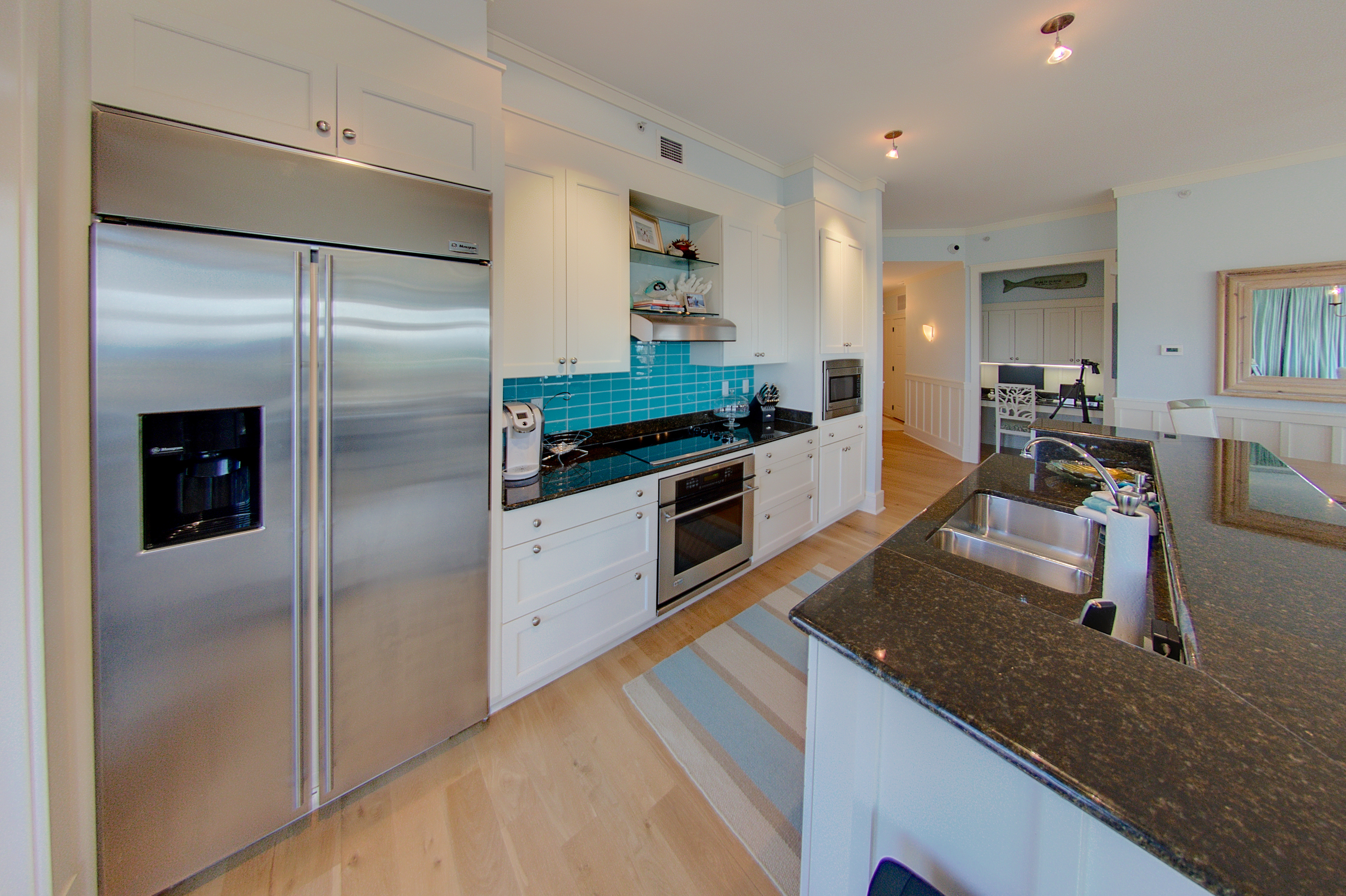 All stainless appliances and a gorgeous tile accents
