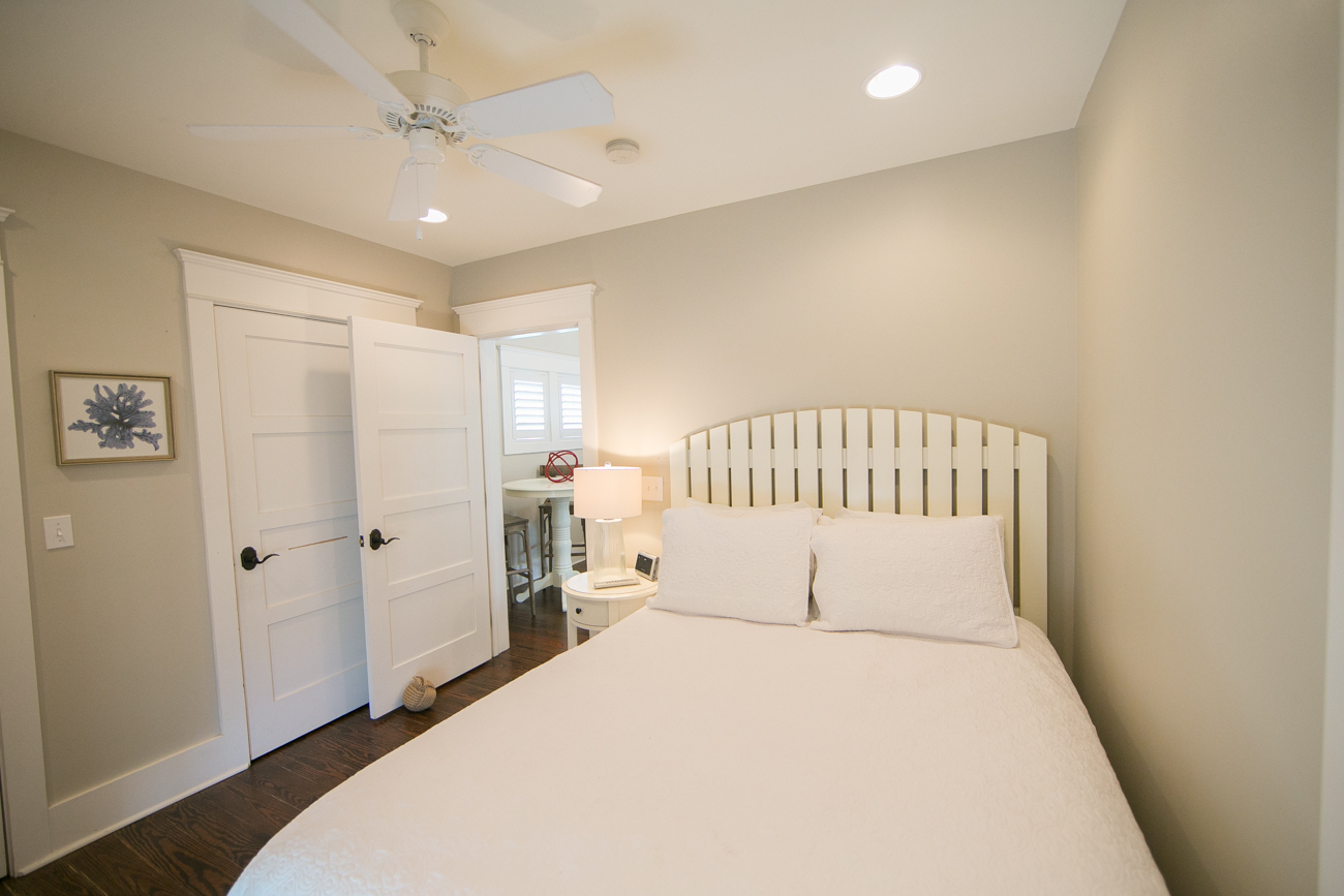 Carriage House Bedroom with closet and separate stacked Washer & Dryer