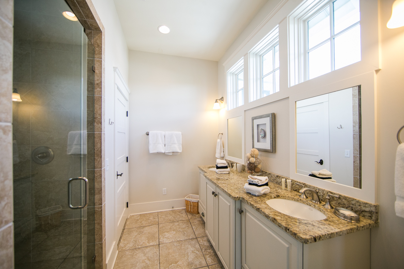 Double Sink Vanity in Master Bath with Walk in Shower and private water closet