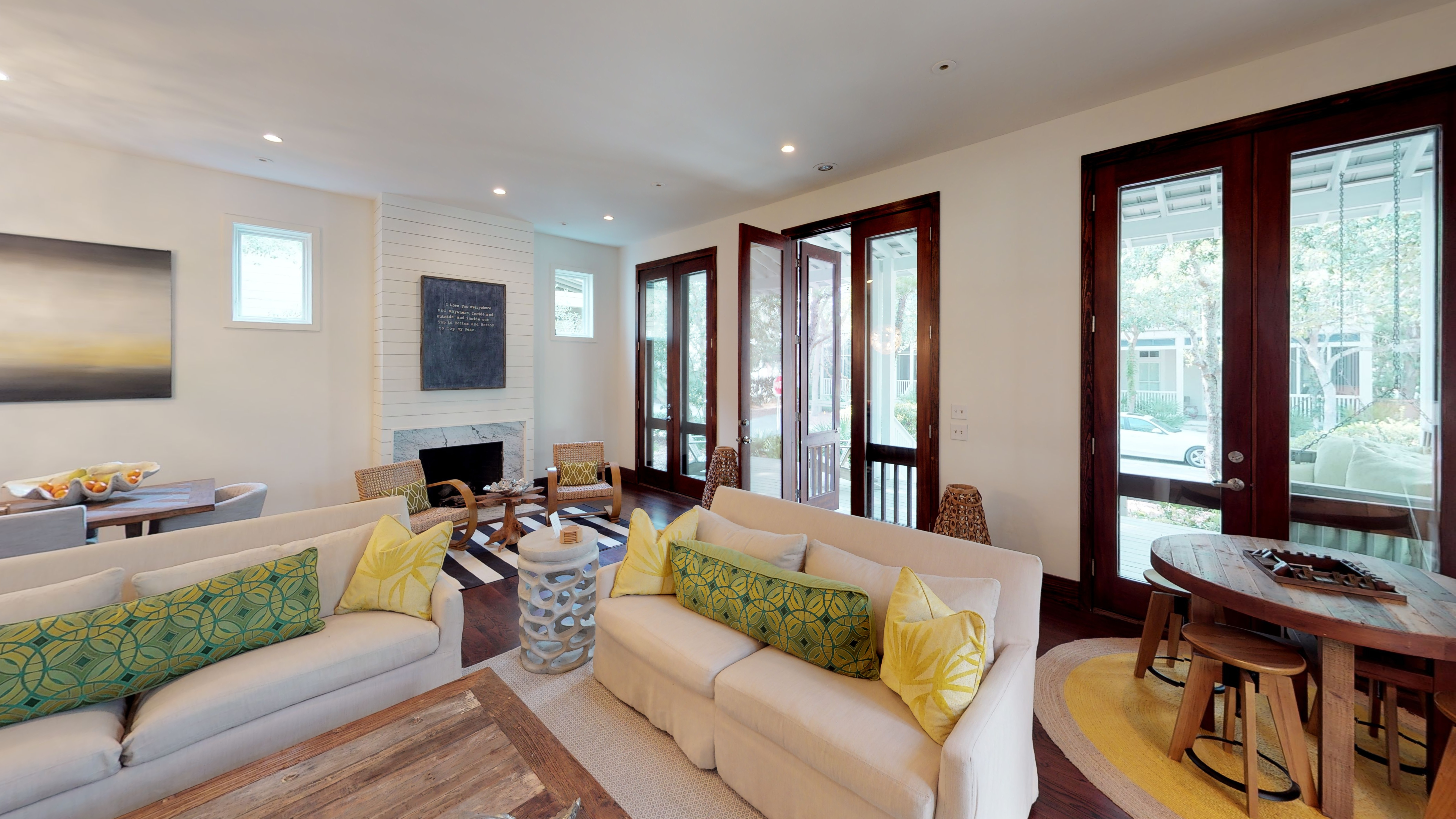 Comfortable living space with gorgeous doors leading to front porch