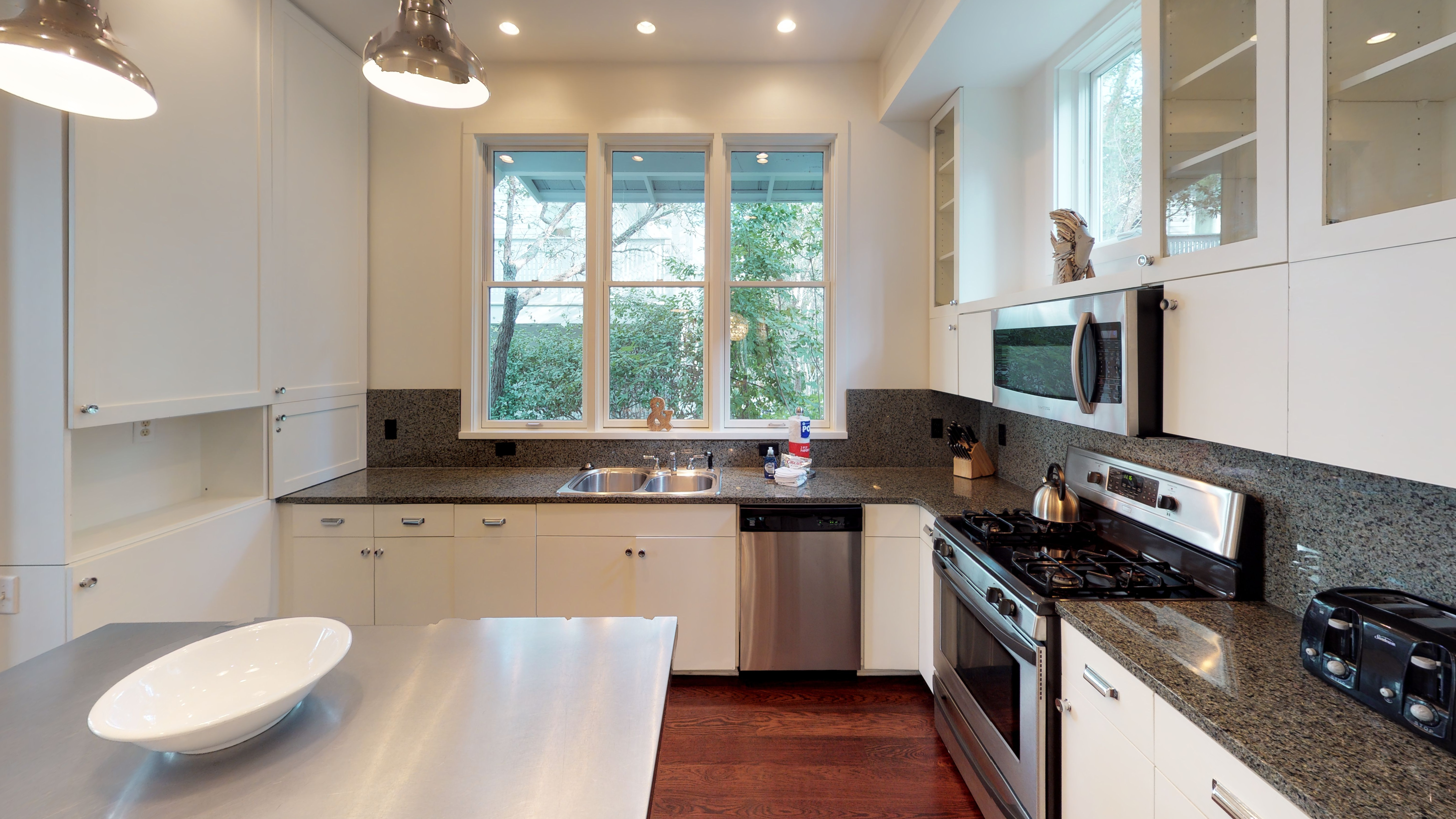 Kitchen featuring granite counters and a gas stove