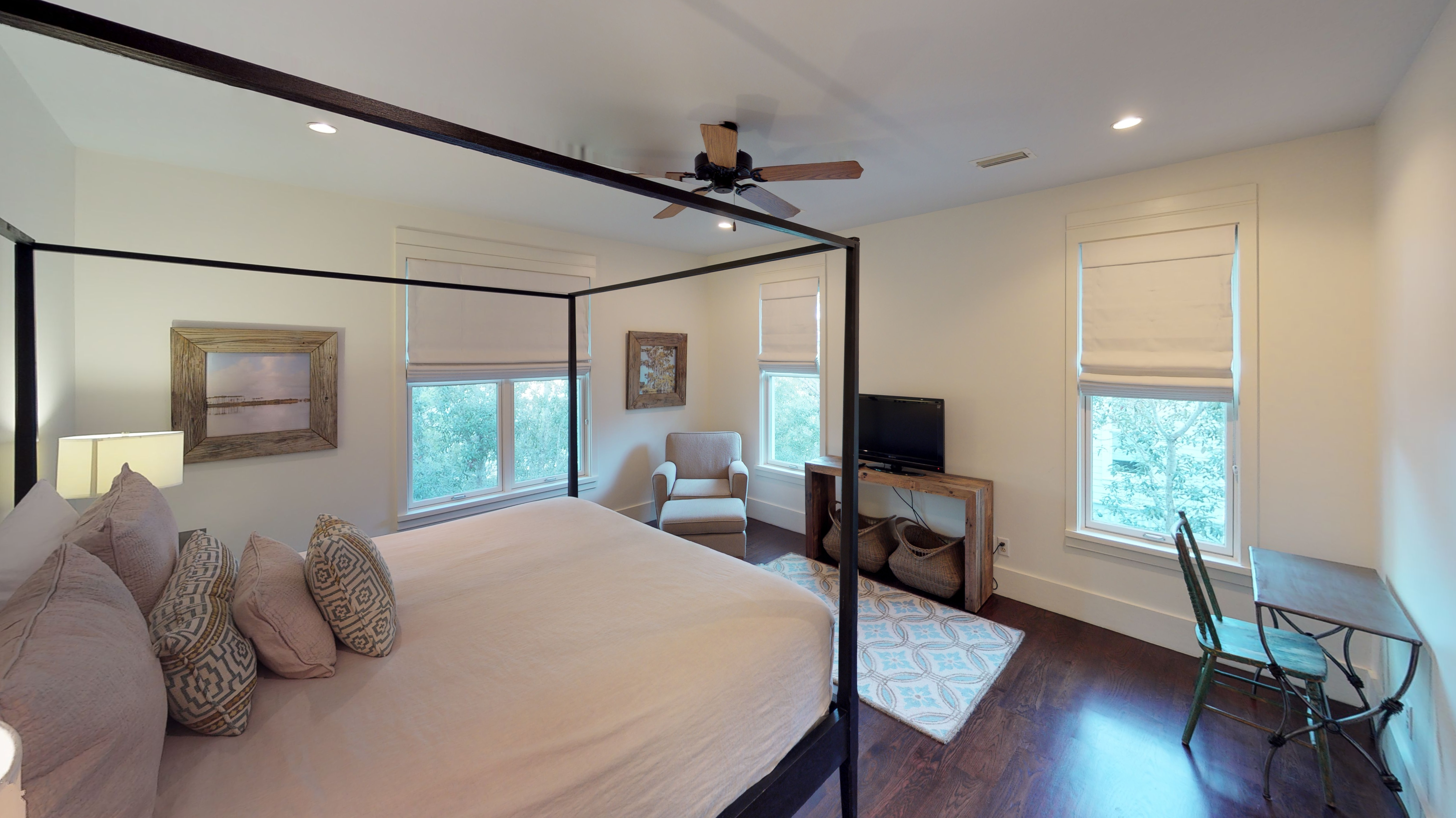 Master bedroom with a king bed