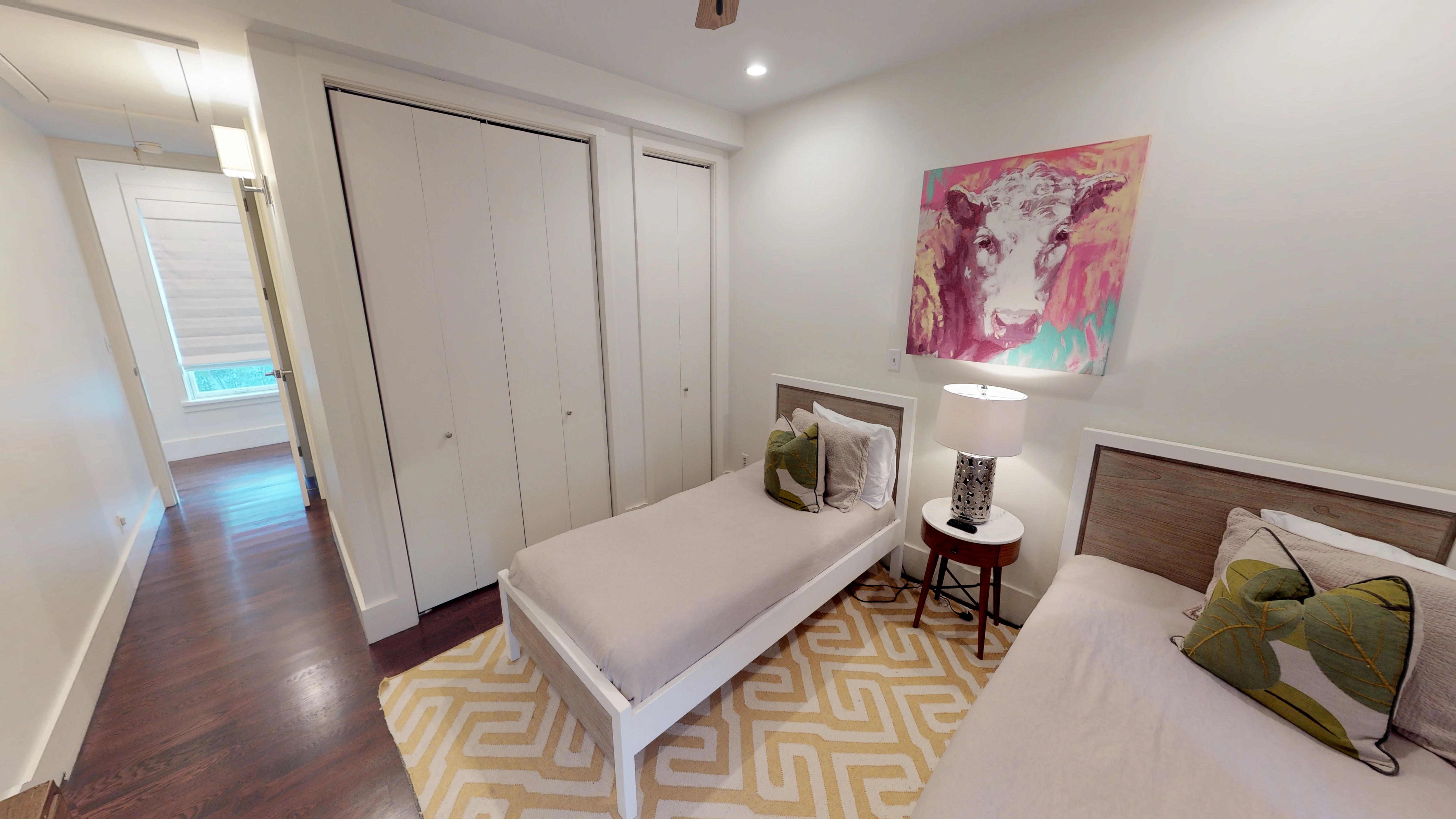 Twin platform beds and colorful artwork