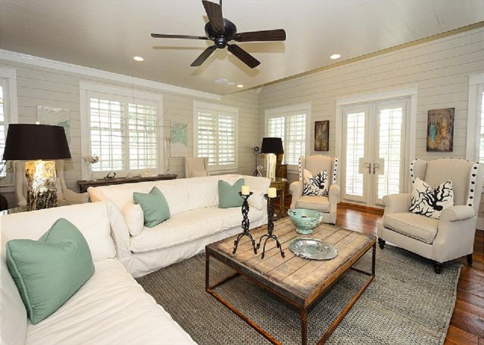 Two Extra Large Couches and Side Seating in this Tastefully Decorated Second Floor Living Room, Doors Open onto Second Floor Porches