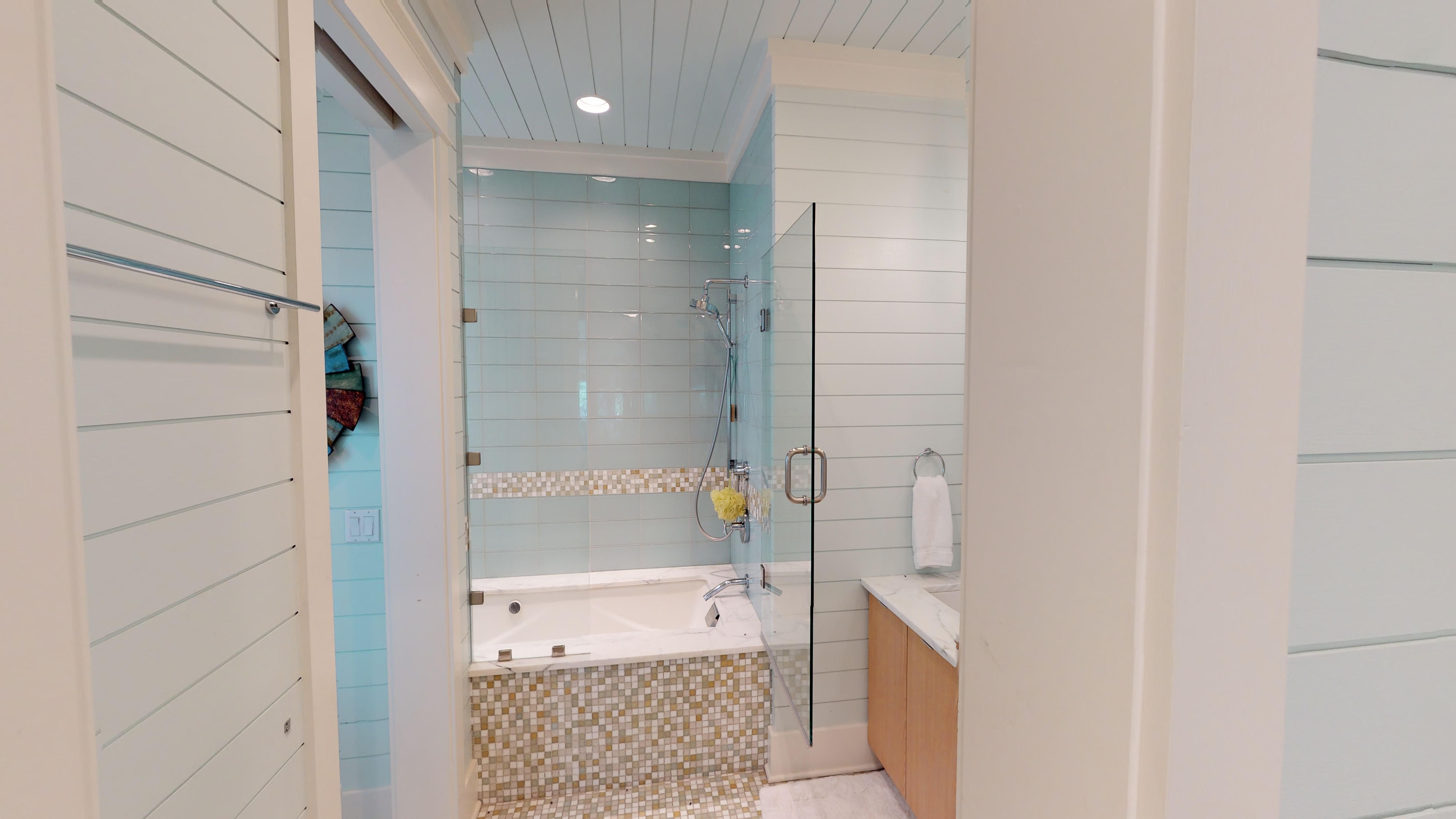 Gorgeous tiled bathroom with a tub/shower combo