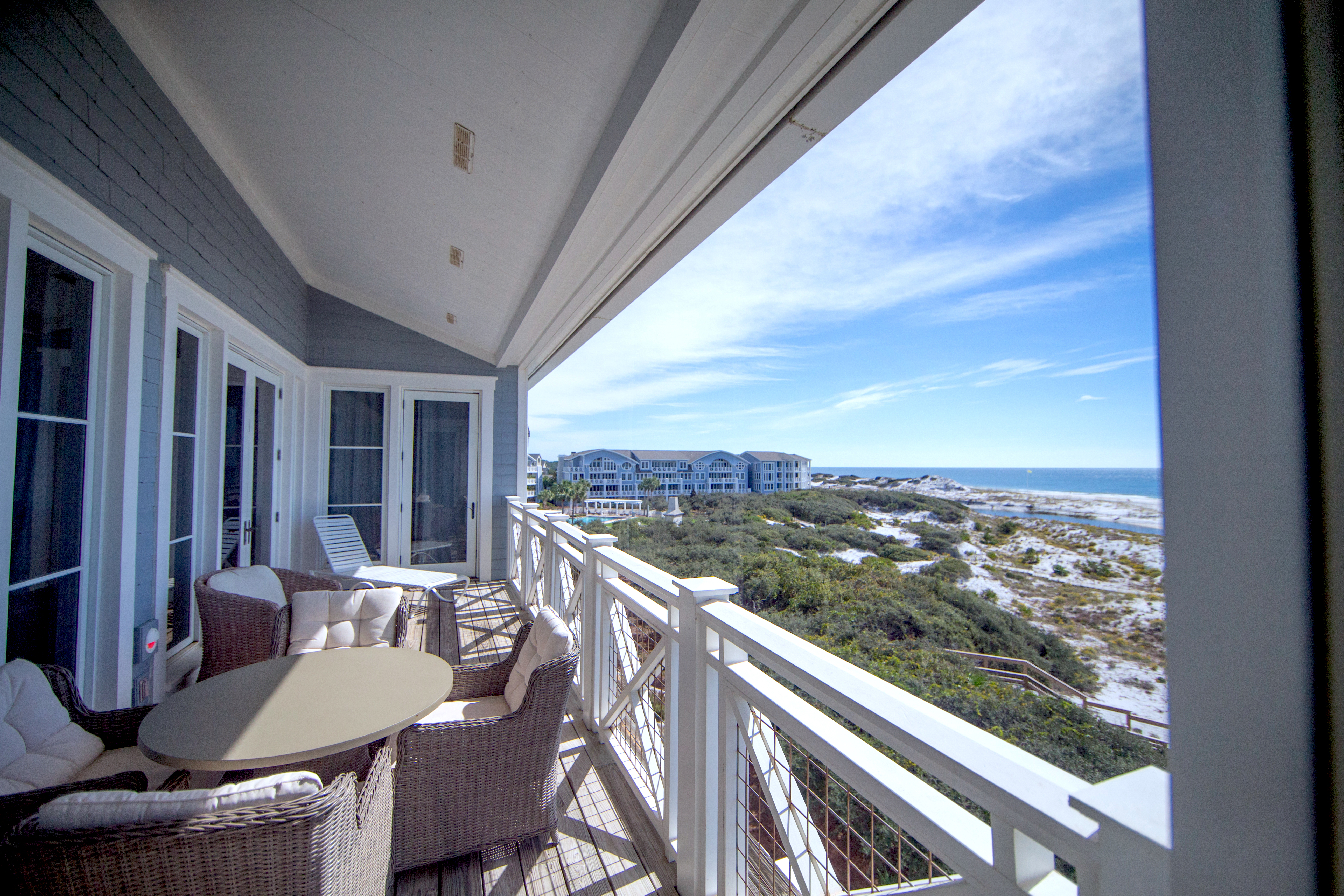 Enjoy watching the dolphins play in the surf from this spacious covered balcony rain or shine.